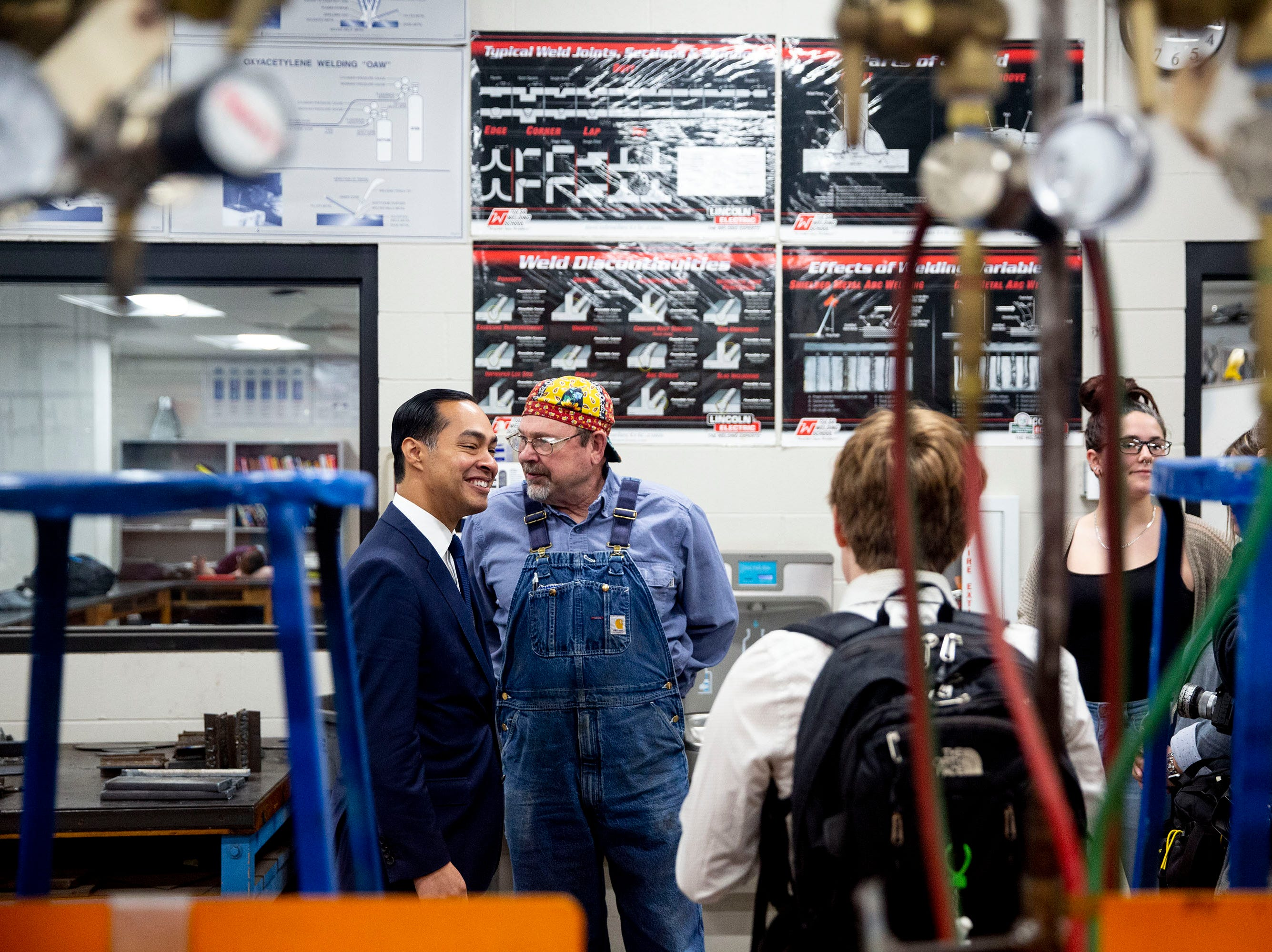 Presidential hopeful Julián Castro tours the Central Campus welding lab and the school's skilled trades academy on Monday, April 15, 2019, in Des Moines.