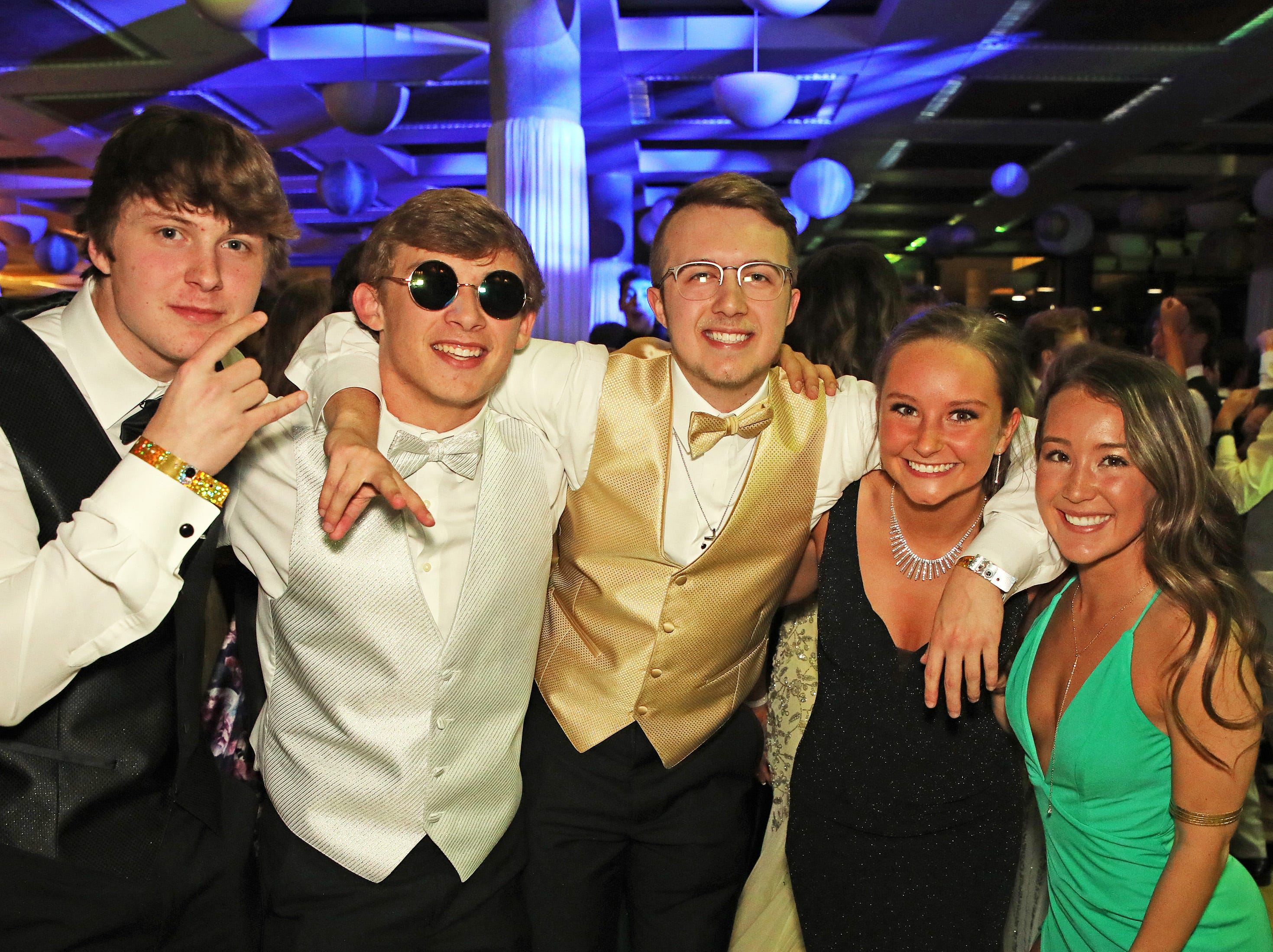 Centennial students pose for a picture during the Ankeny Centennial High School prom at the State Historical Building in Des Moines on Saturday, April 13, 2019.