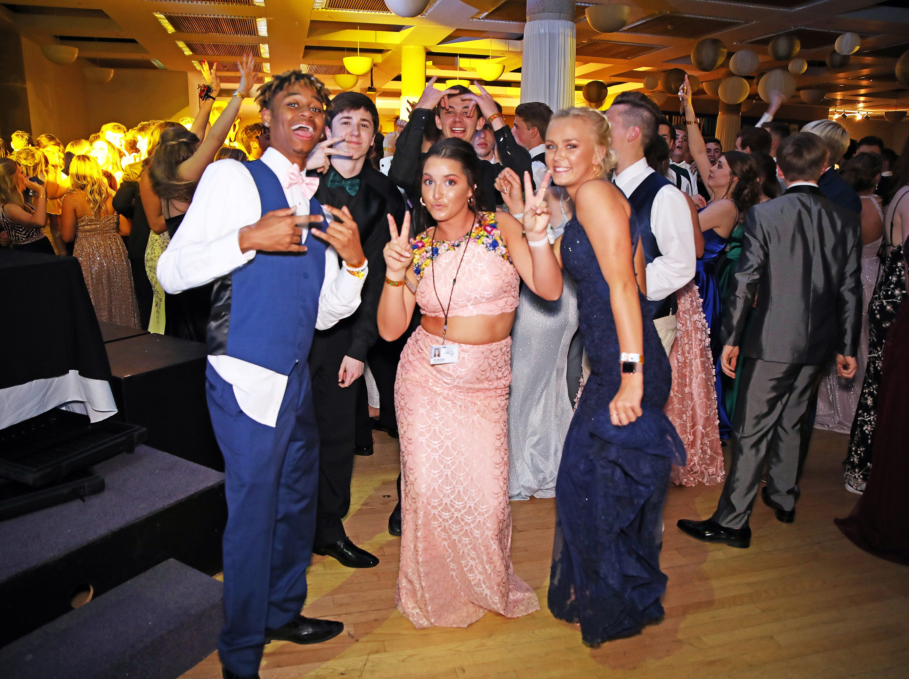 Centennial students pose for a photo during the Ankeny Centennial High School prom at the State Historical Building in Des Moines on Saturday, April 13, 2019.