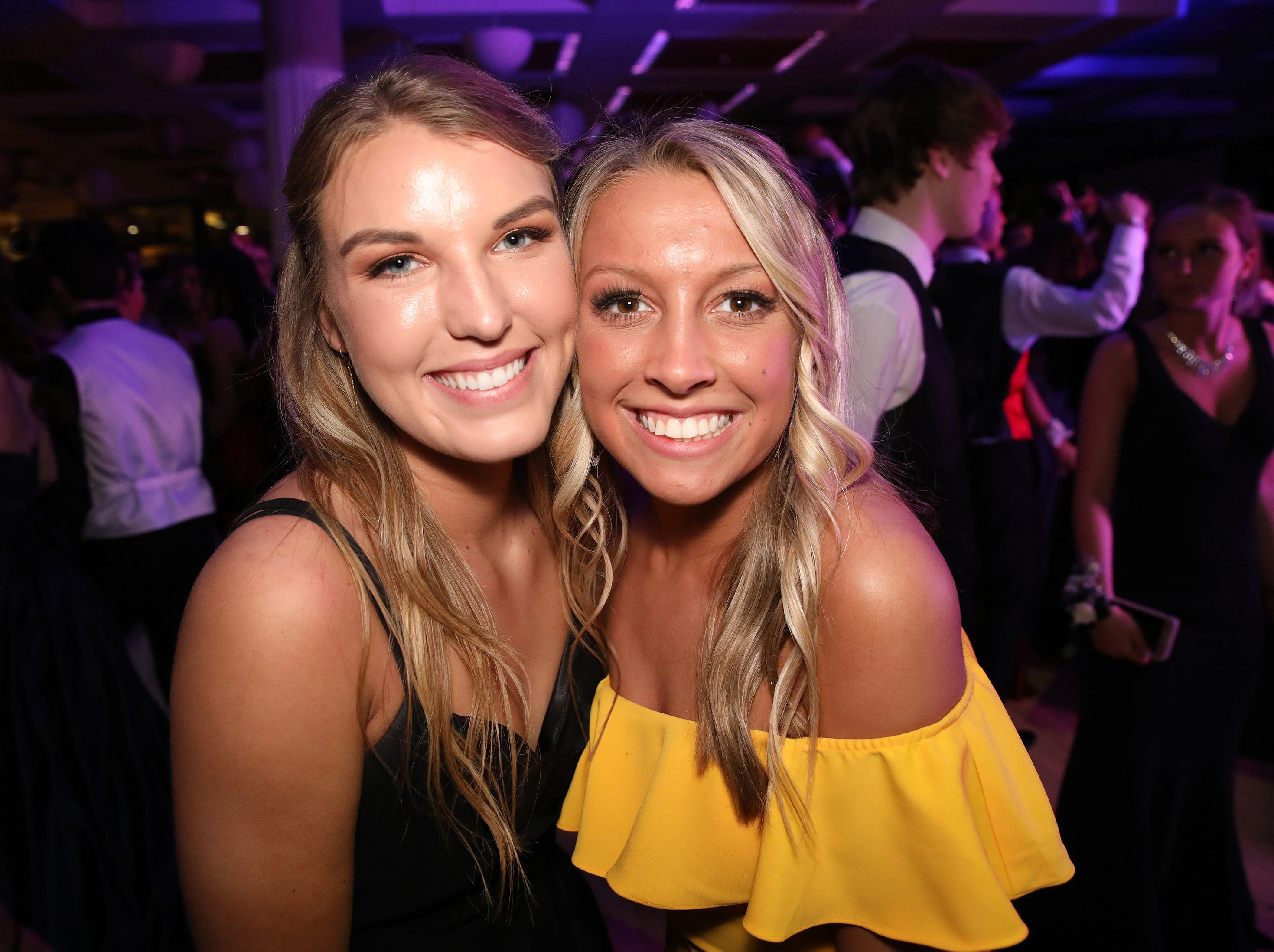Senior Taryn Lindaman, and graduate Payton Enga stop for a picture during the Ankeny Centennial High School prom at the State Historical Building in Des Moines on Saturday, April 13, 2019.