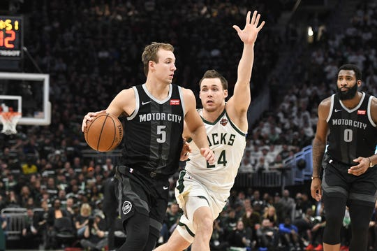 Luke Kennard drives against the Bucks' Pat Connaughton during the third quarter of Game 1 at Fiserv Forum on Sunday.