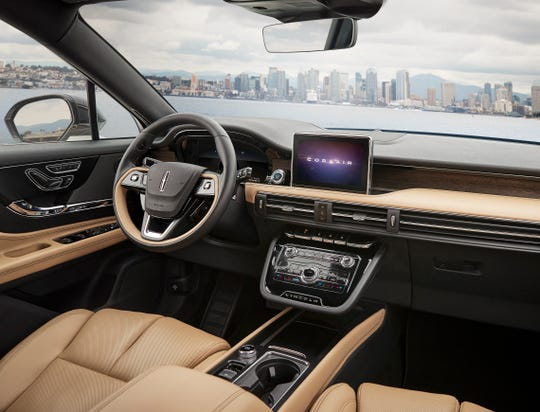 The 2020 Lincoln Corsair's instrument panel has a floating panel with controls for audio and climate