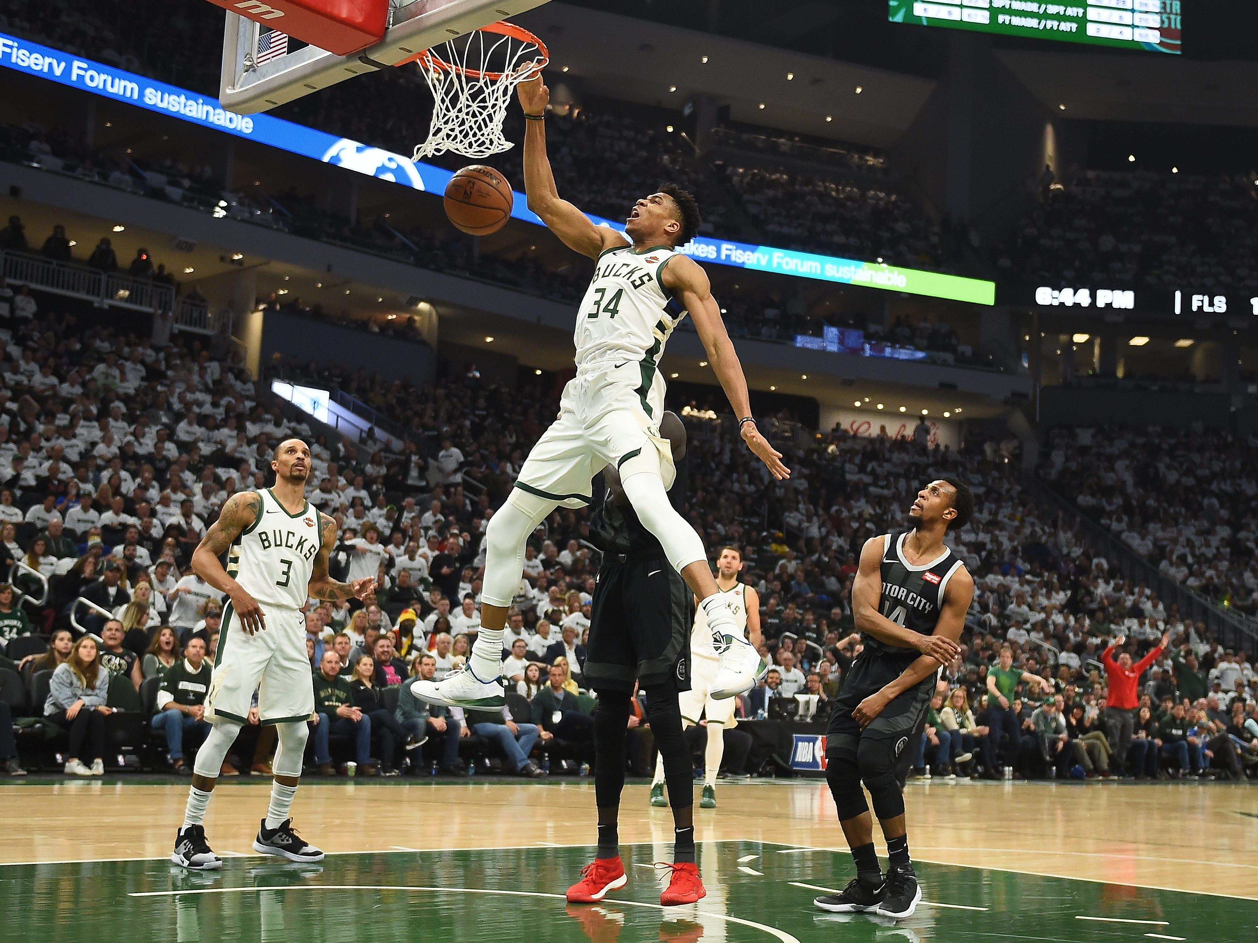 Milwaukee Bucks' Giannis Antetokounmpo dunks against the Detroit Pistons during Game 1 at Fiserv Forum on April 14, 2019 in Milwaukee.