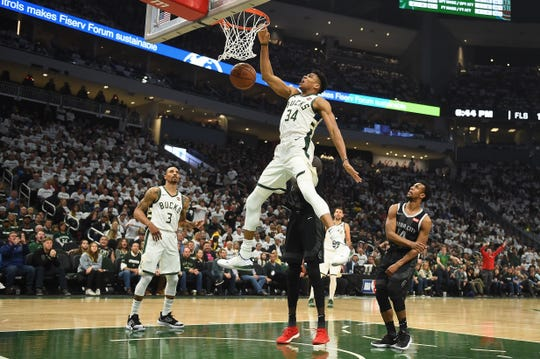 Giannis Antetokounmpo dunks against the Pistons on Sunday at Fiserv Forum in Milwaukee.