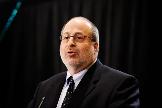 In this Dec. 16, 2008, photo, Jonathan Wolman, Editor and Publisher of The Detroit News, speaks during an announcement at the Detroit Free Press and The Detroit News during a news conference in Detroit. Wolman, who served as editor and publisher of The Detroit News and previously worked as a reporter, Washington bureau chief and executive editor at The Associated Press, died Monday, April 15, 2019, in Detroit. He was 68.