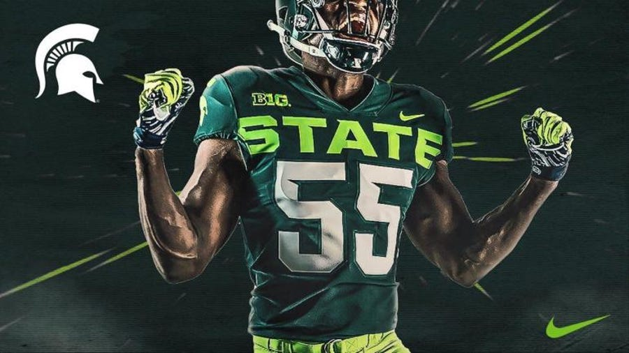 There's so much neon in the new MSU unis, you'd think the Spartans lost a bet with Oregon, and not just the Redbox Bowl.