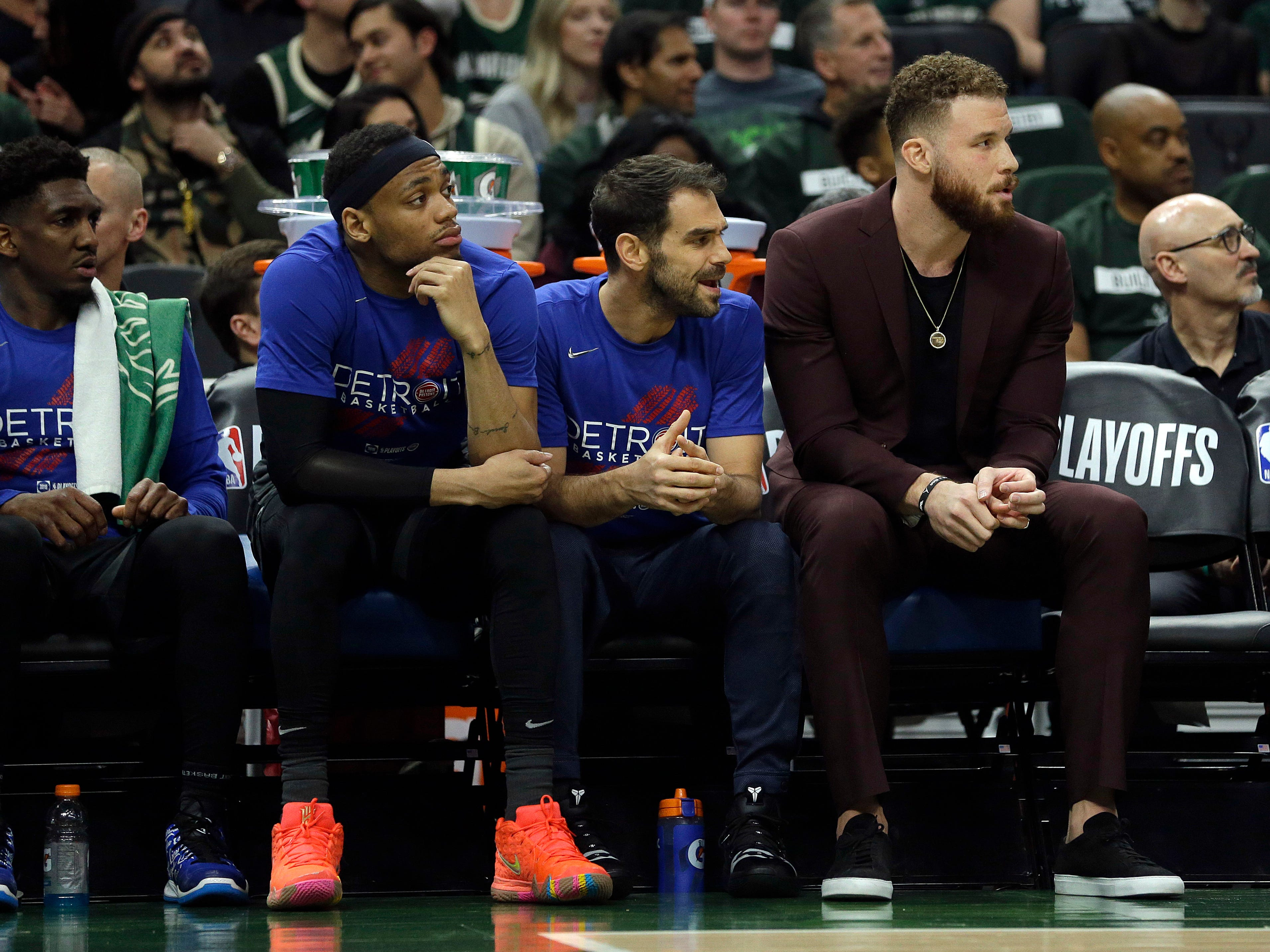 Detroit Pistons' Blake Griffin, right, Jose Calderon, center, and Bruce Brown, left, watch from the bench during the first half of Game 1 against the Milwaukee Bucks, Sunday, April 14, 2019, in Milwaukee.