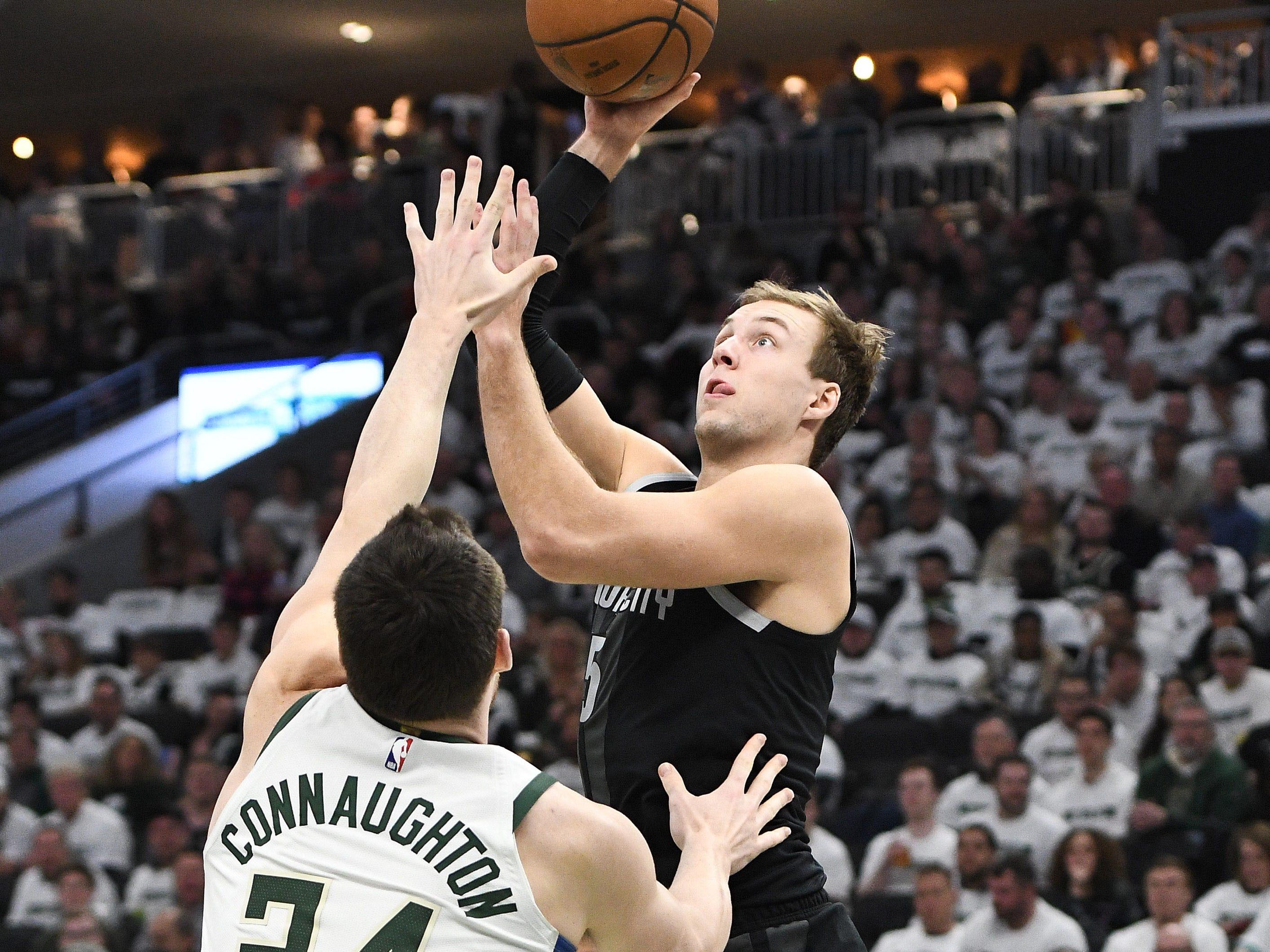 Detroit Pistons guard Luke Kennard shoots against Milwaukee Bucks forward Pat Connaughton during the third quarter of Game 1 at Fiserv Forum, April 14, 2019. The Bucks won, 121-86.