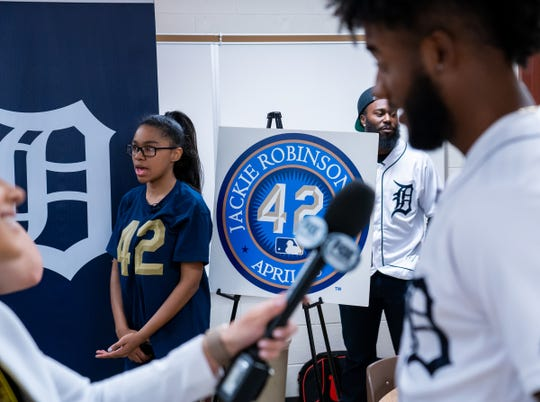 West Hills Middle School student Gabrielle Porter and Detroit Tigers players Niko Goodrum (right) and Josh Harrison are interviewed individually after it was announced that Porter was chosen as one of the top 10 nationwide finalists for her essay for Jackie Robinson Day. Porter was honored by the Detroit Tigers amongst classmates at the school in West Bloomfield Township on Monday, April 15, 2019.