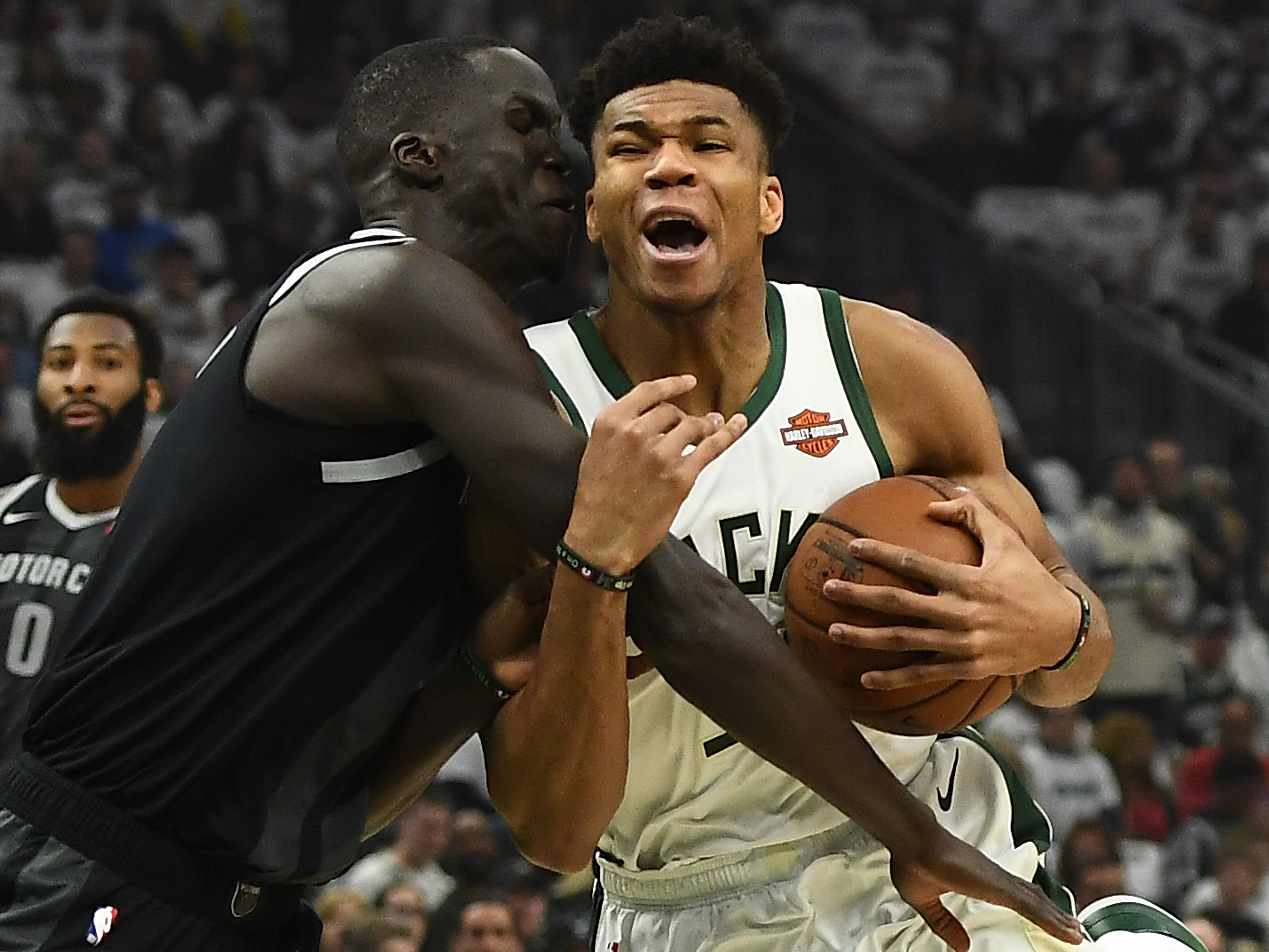 Giannis Antetokounmpo of the Milwaukee Bucks is fouled by Thon Maker of the Detroit Pistons during Game 1 at Fiserv Forum on April 14, 2019 in Milwaukee.