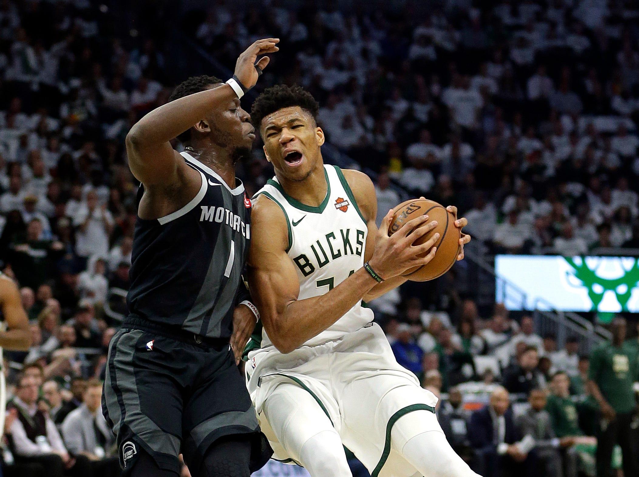Milwaukee Bucks' Giannis Antetokounmpo drives to the basket against Detroit Pistons' Reggie Jackson during the second half.