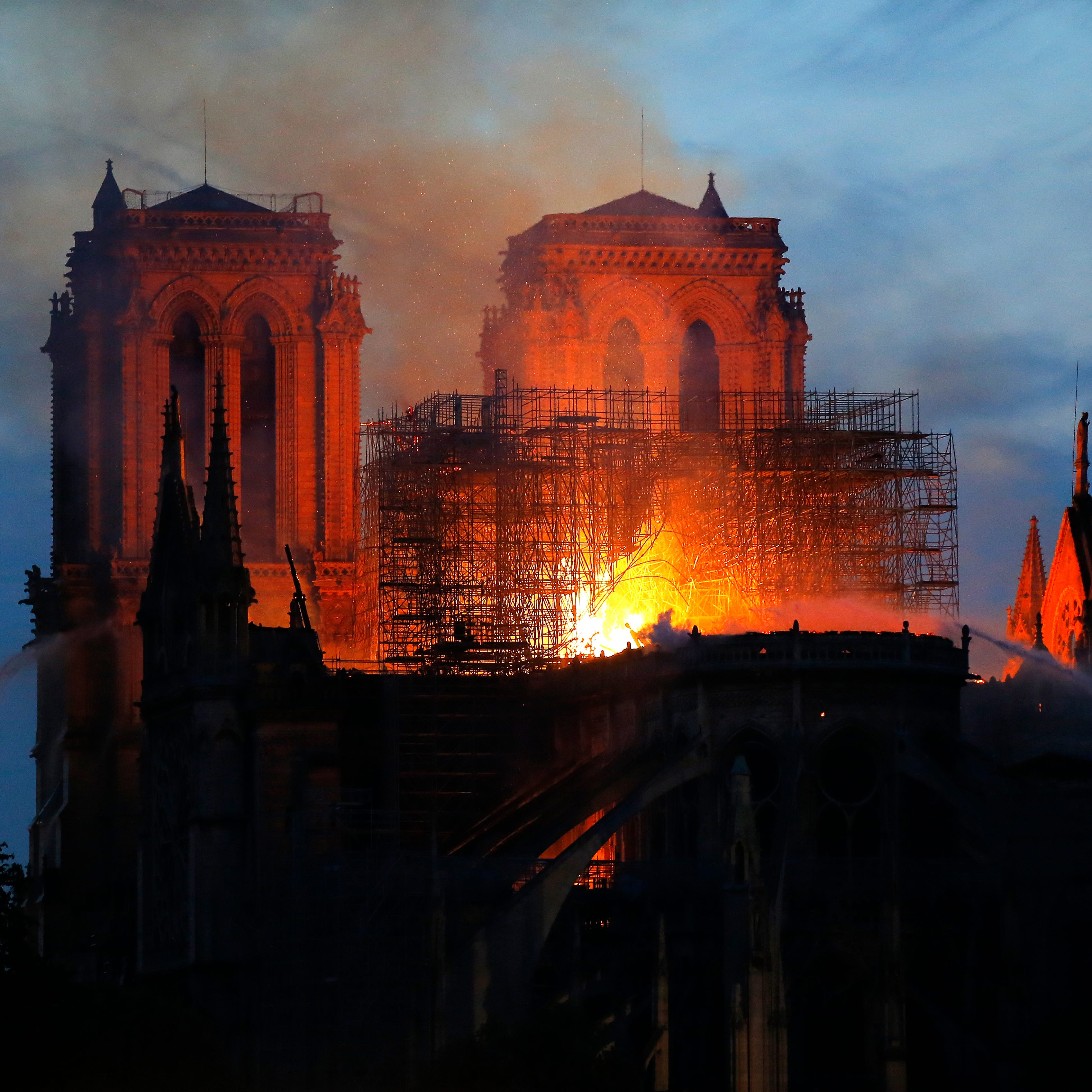 Notre Dame Cathedral's spire collapses in blaze, but structure saved, chief says
