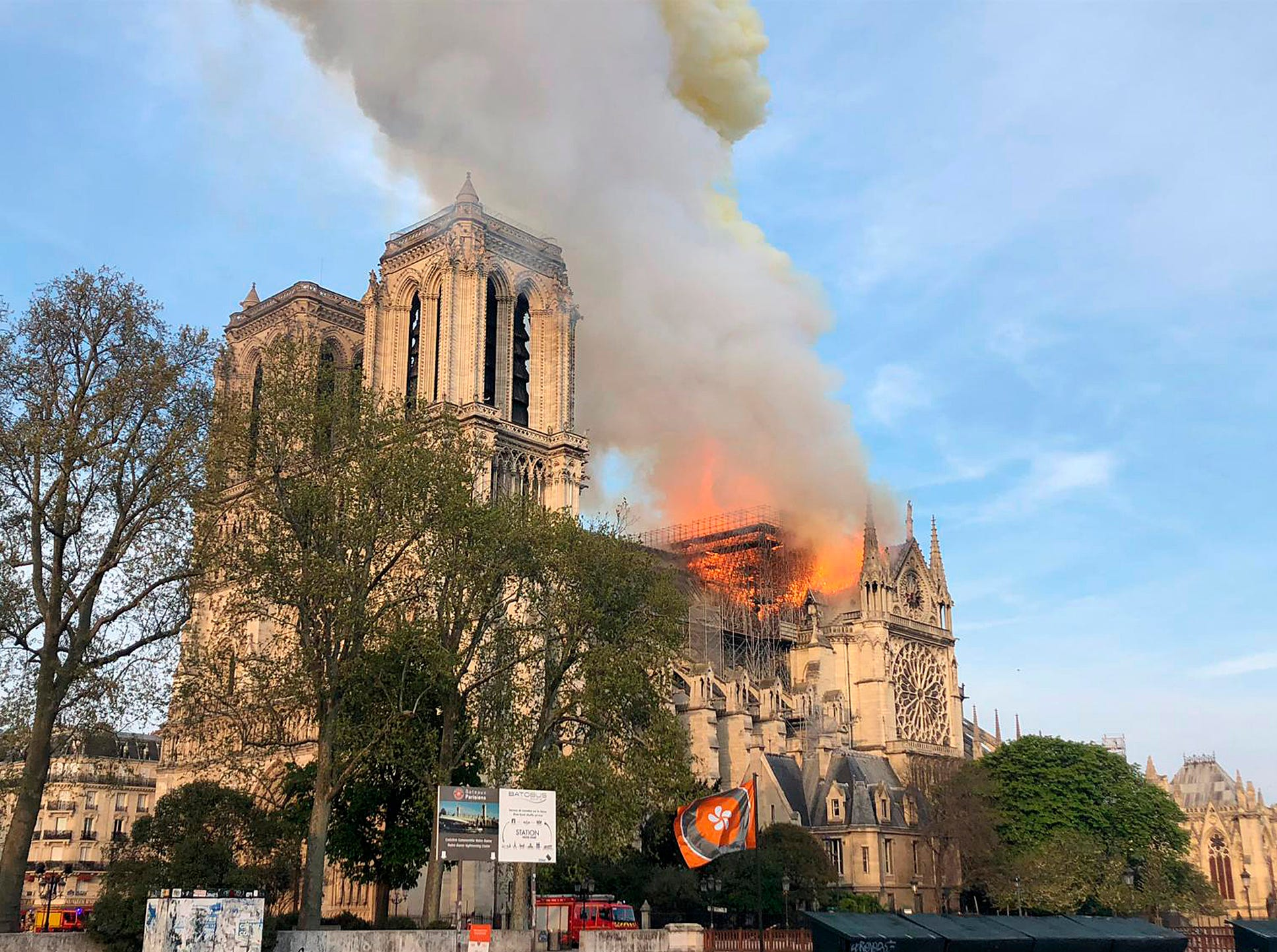Notre Dame cathedral burns in Paris, Monday, April 15, 2019. Ash is falling on tourists and others around the island that marks the center of Paris.