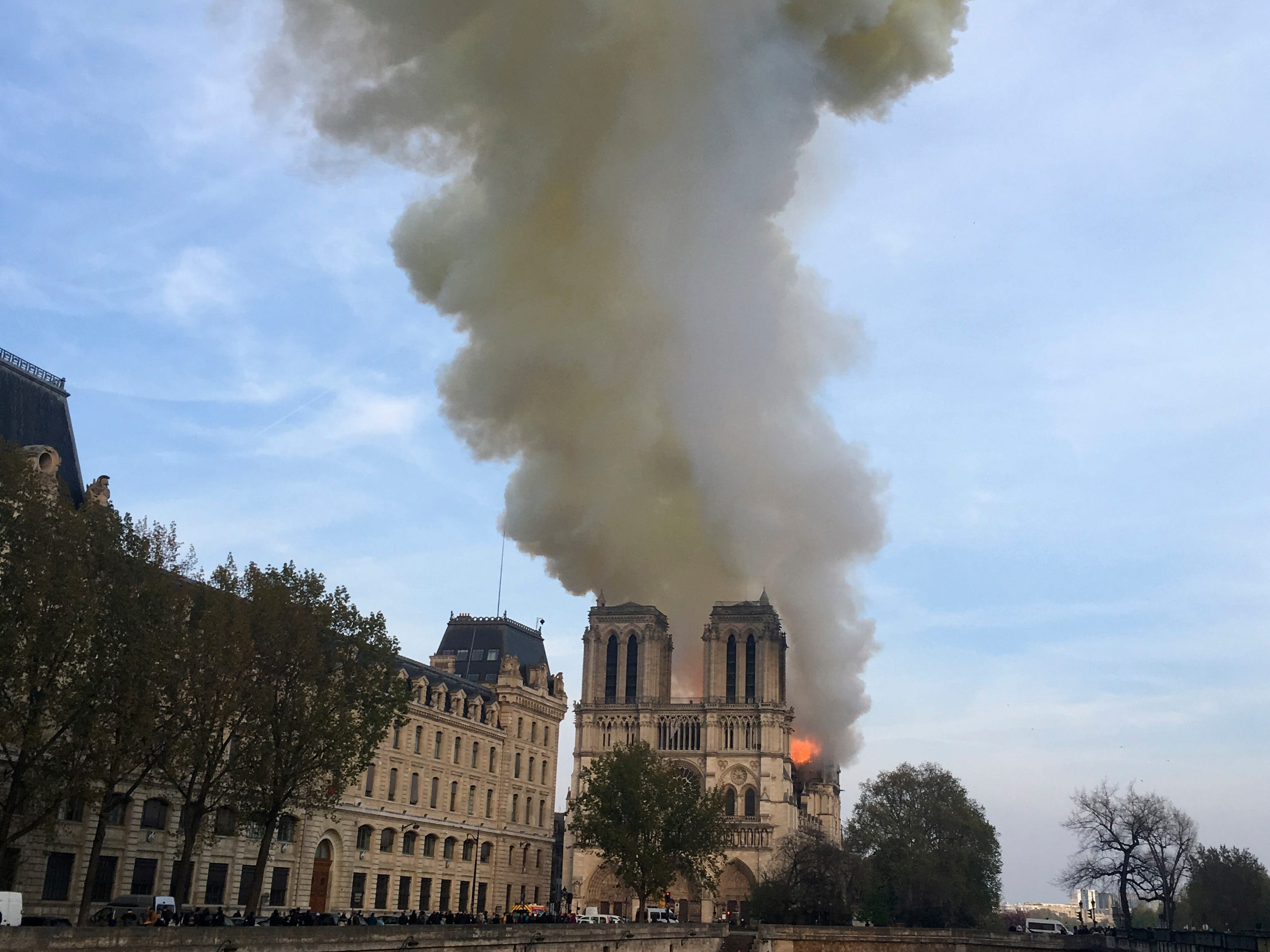 Smoke and flames rise from Notre Dame cathedral in Paris Monday.