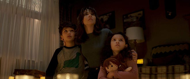 "Roman Christou, Linda Cardellini and Jaynee-Lynne Kinchen in ""The Curse of La Llorona."""