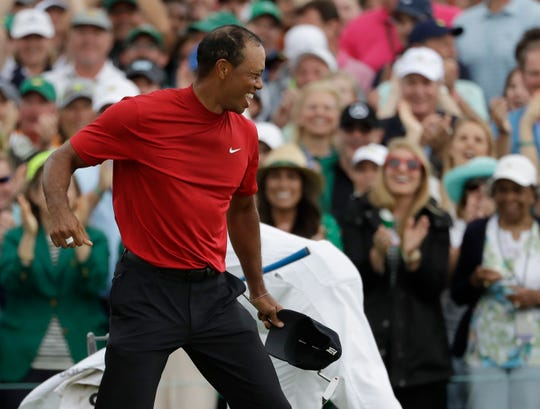 Tiger Woods reacts as he wins the Masters for the first time since 2005.