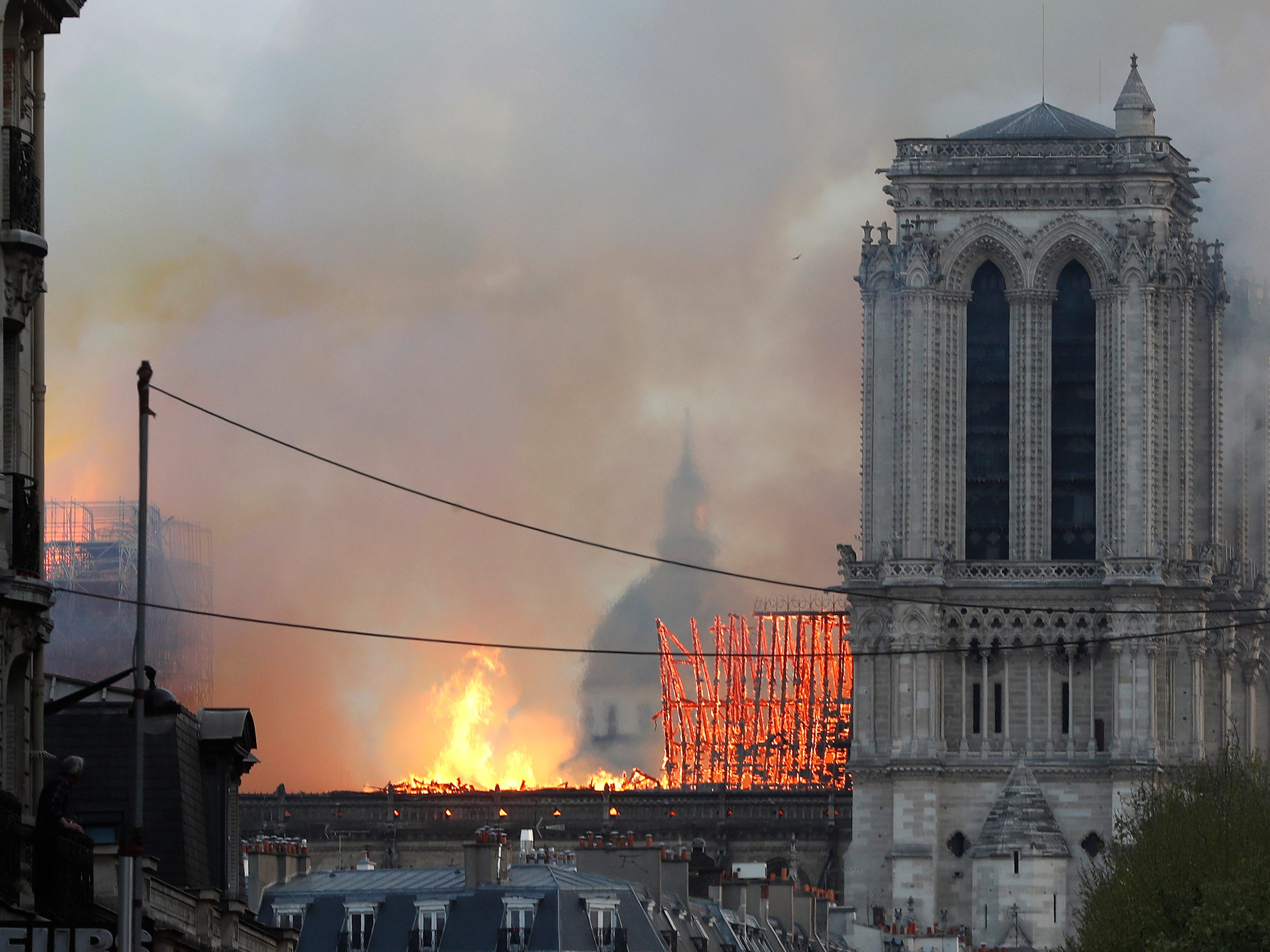 Flames rise from Notre Dame cathedral as it burns in Paris, Monday.