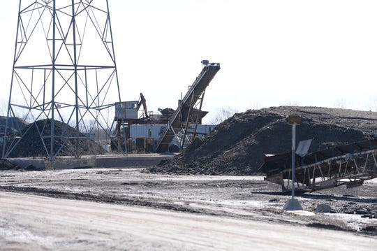 Contractor Rodney Burrell owns this crushing and recycling site in Wixom, which has earned him at least $315,000 in federal money for supplying dirt in Detroit's demolition program. Burrell was sentenced to two years' probation in 2012 in a federal bid-rigging case against ex-Mayor Kwame Kilpatrick's friend, Bobby Ferguson.