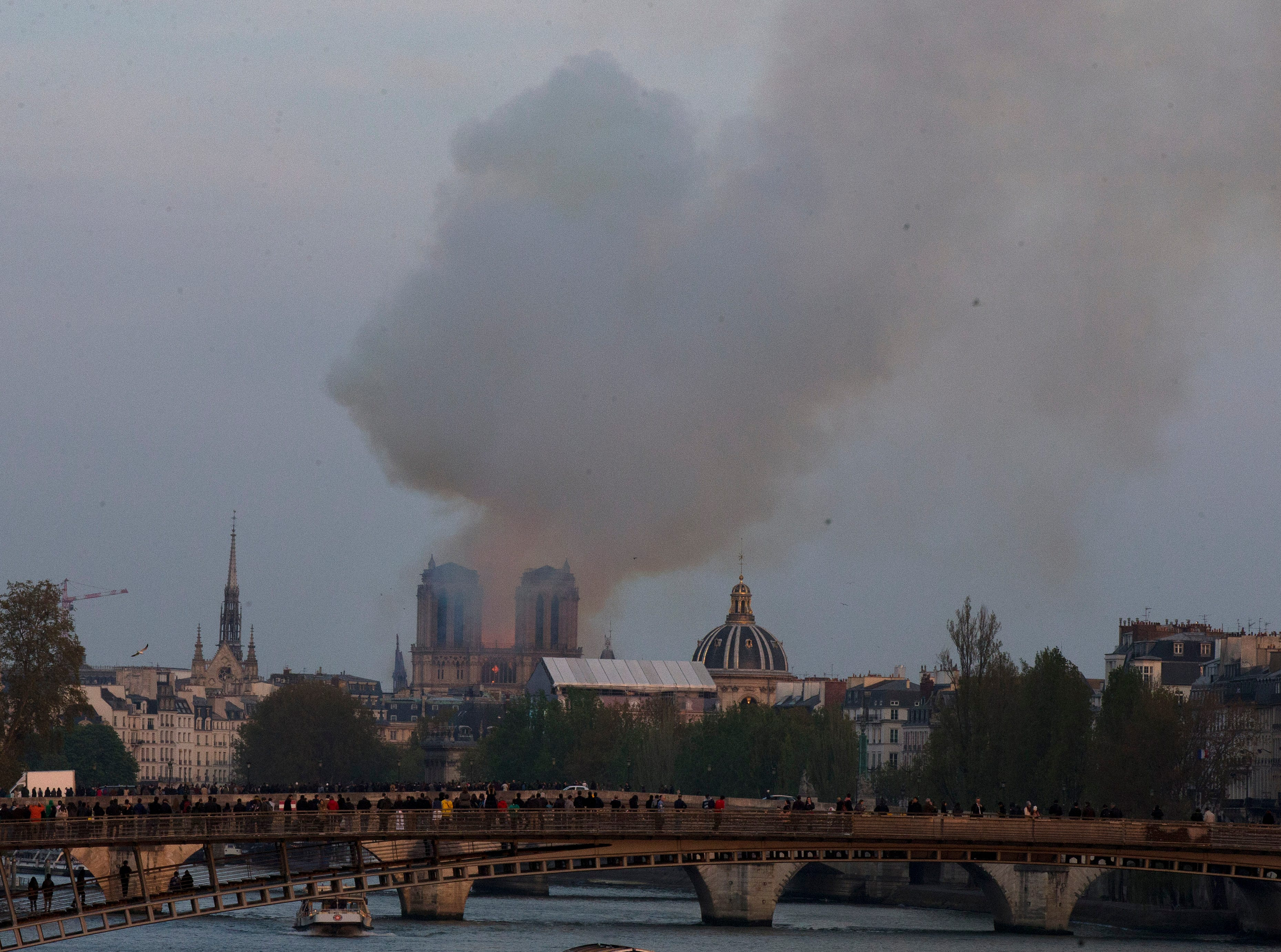 Flames and plumes of smoke rise from Notre Dame cathedral  Monday evening.