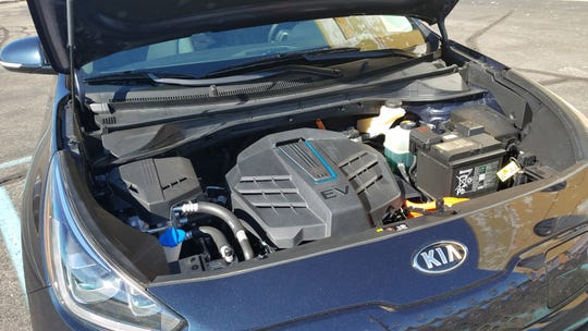 The 2019 Kia Niro EV packs its electric motor and other electronics under the front hood where you'll find the gas engine in a standard Niro. The EV will cost about $15k north of its gas sibling.