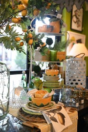 Jumping on the yellow trend, this citrus-inspired setting brings a breath of fresh air into any room. Bring natural elements in with faux lemon branches to add another level of design. (Handout)