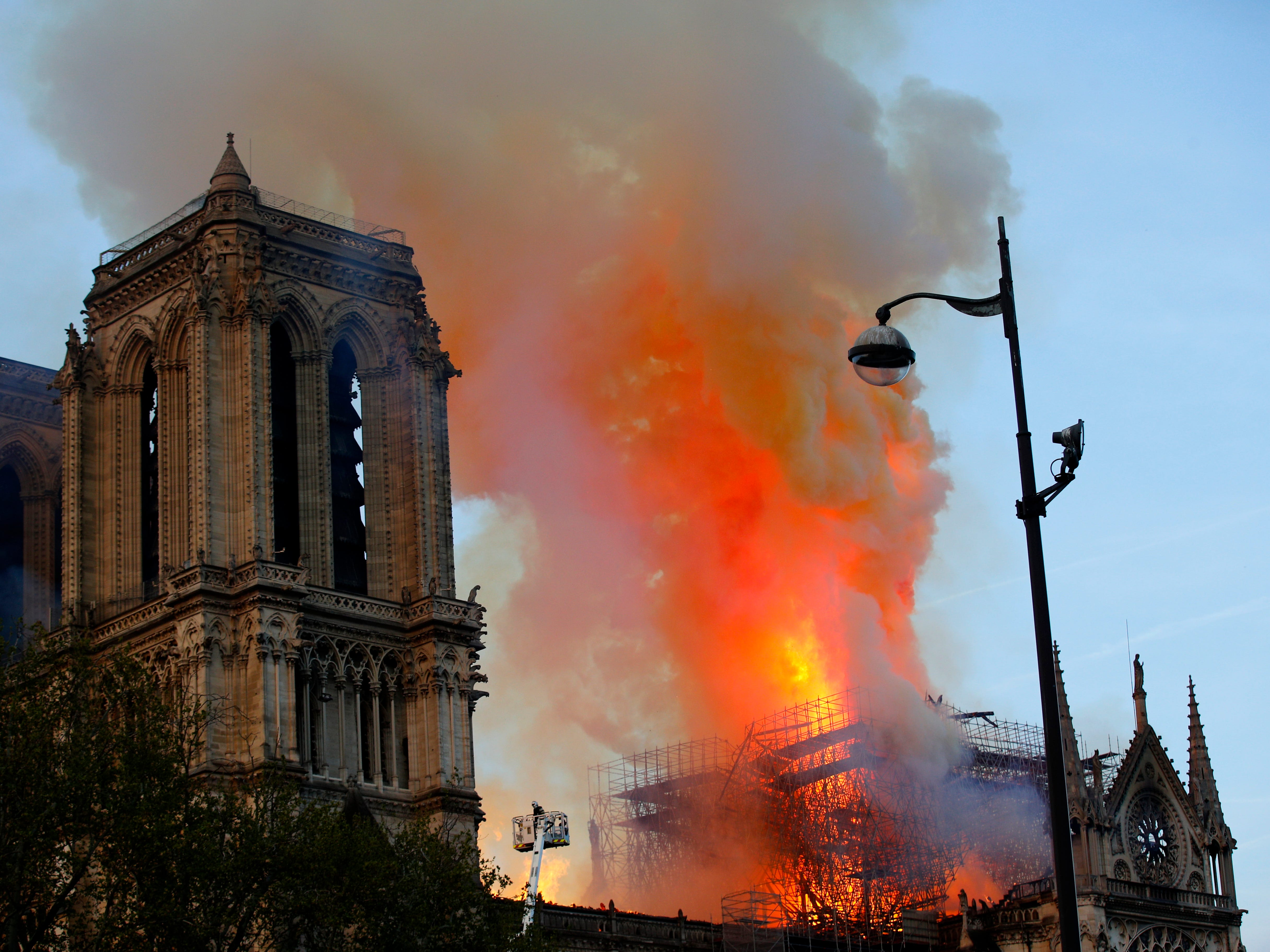 Firefighters try to contain the blaze as Notre Dame cathedral burns in Paris.