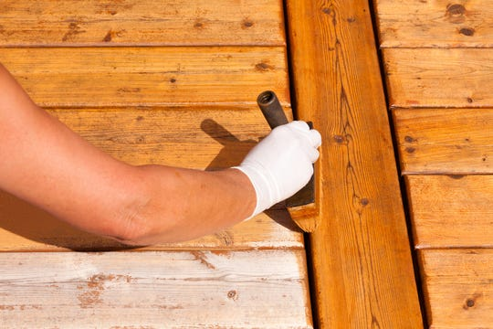 Resealing and staining can adds years to your deck's life. (Dreamstime)