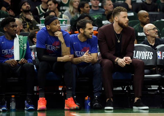 Pistons forward Blake Griffin, right, watches from the bench during the first half of Game 1 of an NBA playoff series against Milwaukee on Monday.