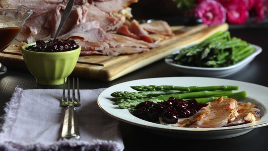 Instead of using a sweet glaze on the Easter ham, this recipe calls for a homemade cherry chutney, which brings sweet and tart notes. (Abel Uribe/Chicago Tribune/TNS)