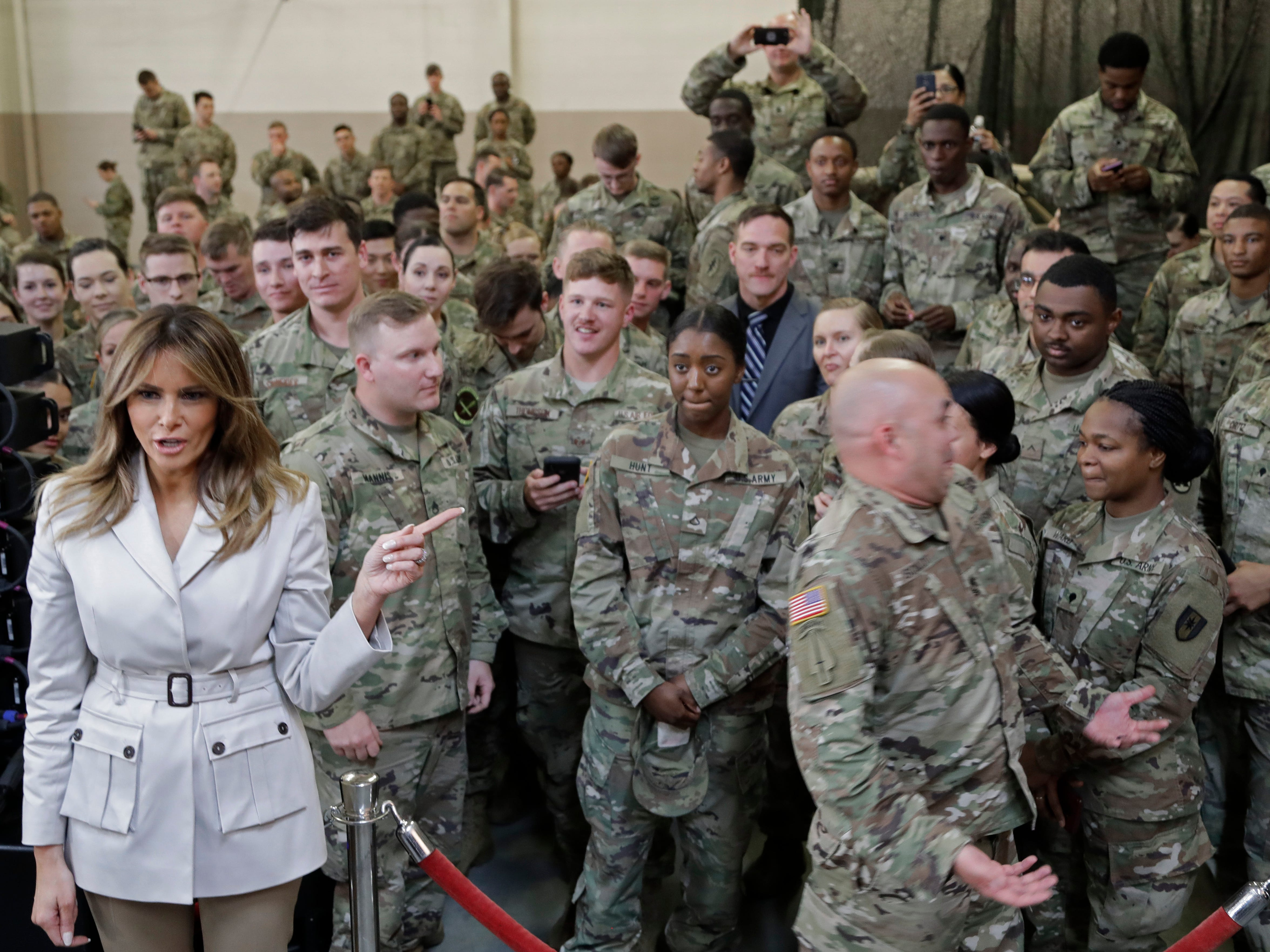 First lady Melania Trump points to a soldier who she was photographed with after addressing service personnel and family members in Ft. Bragg, N.C., Monday, April 15, 2019.