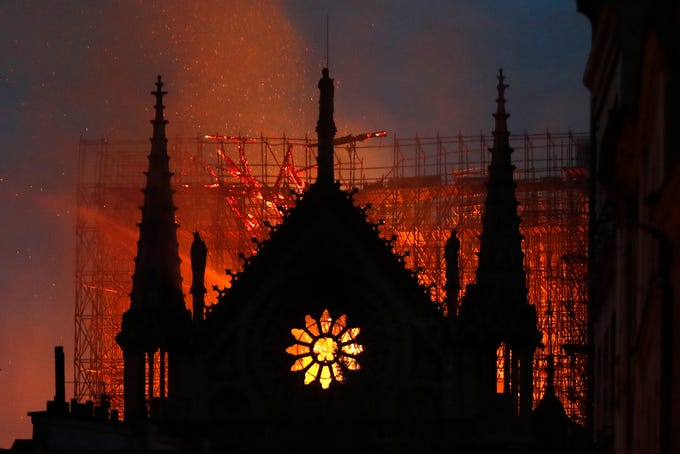 Flames and smoke rise from Notre Dame cathedral as it burns in Paris, Monday night, April 15, 2019. A catastrophic fire engulfed the upper reaches of Paris' soaring cathedral as it was undergoing renovations Monday, threatening one of the greatest architectural treasures of the Western world as tourists and Parisians looked on aghast from the streets below.