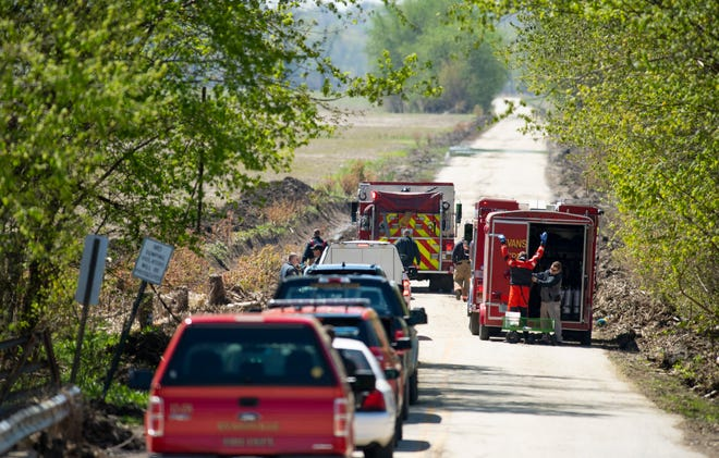 Search and rescue personnel gear-up as the recovery of a body found east of S. Weinbach Avenue continues Monday morning. The identity of the body was not released pending a coroner's announcement.