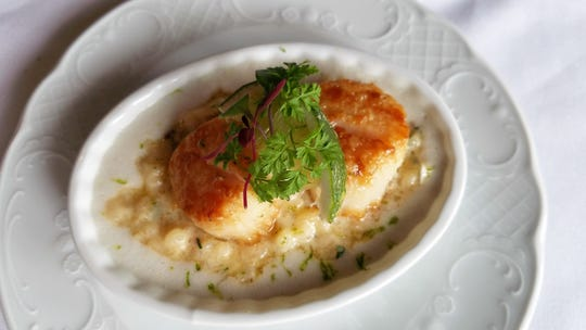 Pan fried scallops with risotto and coconut ginger nage at the Red Geranium in New Harmony.