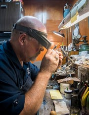 Bryan Turley, owner of Turley Mfg. Jewelers, repairs a ring while sitting at his workbench, Thursday, April 11, 2019.