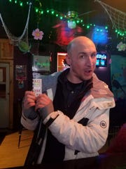 Jenny Reinhold, owner of Jenz Bar in North Fond du Lac, shares a photo of Charles Percy and his winning pull-tab-ticket that later turned out to be fraud, on April 10. He was out on bail at the time for allegedly committing the same kind of fraud on March 11 at Varsity Bar & Grill in Sun Prairie.