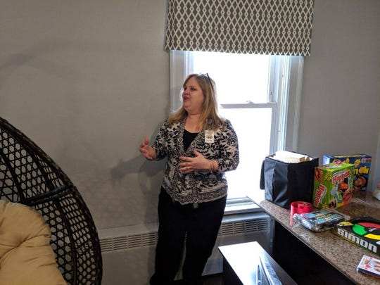 Village House Executive Director Sue Fuller explains how $6,000 raised by Fremont service groups is being used to renovate a play room at the home that hosts third party visits for families in the Sandusky County court system.