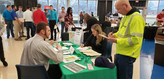 An area student meets with business recruiters at the annual THINK Job Fair.