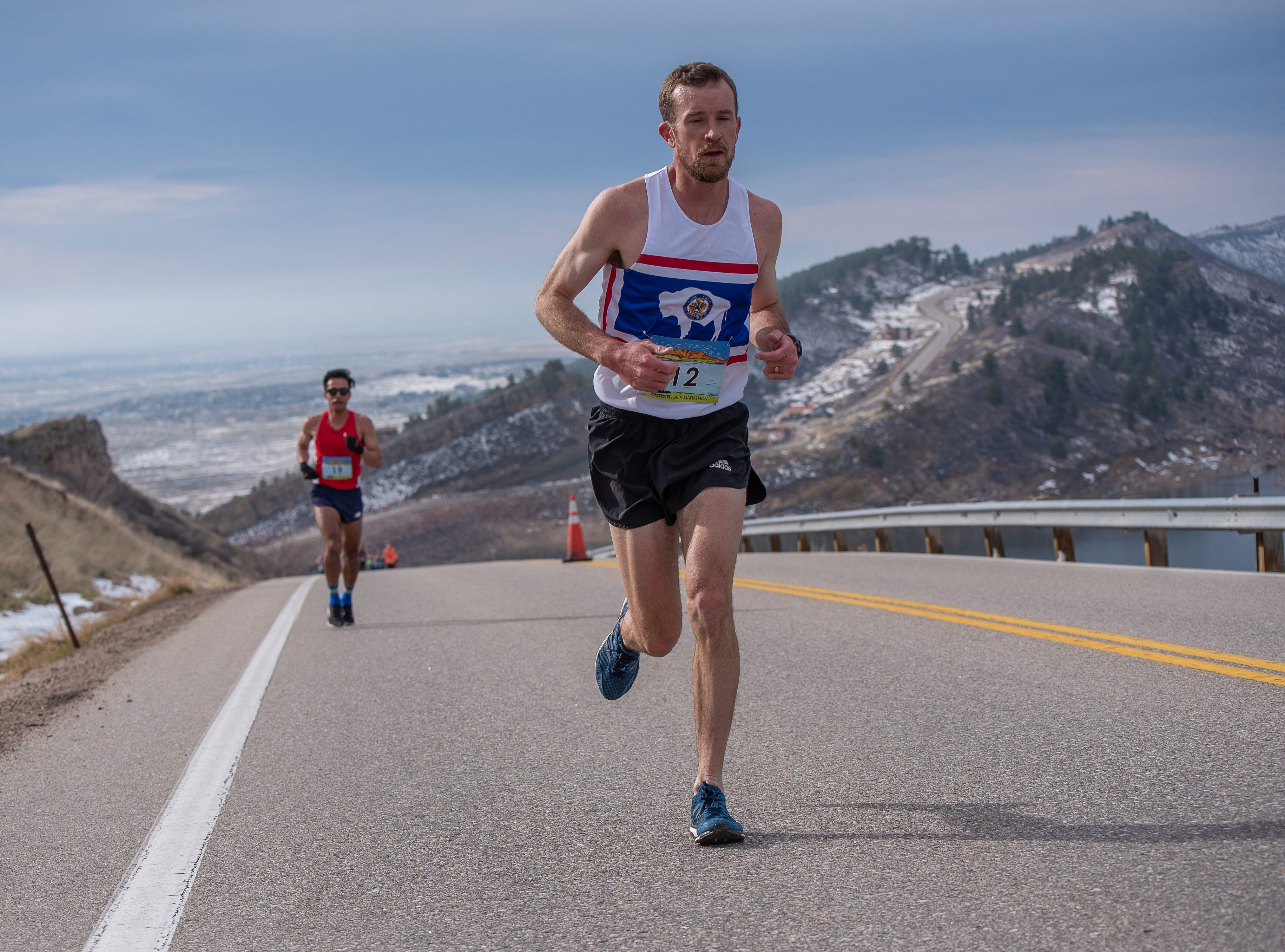 Elite runners approach the top of Monster Mountain along Horsetooth Reservoir during the Horsetooth Half Marathon on Sunday, April 14 2019, in Fort Collins, Colo.