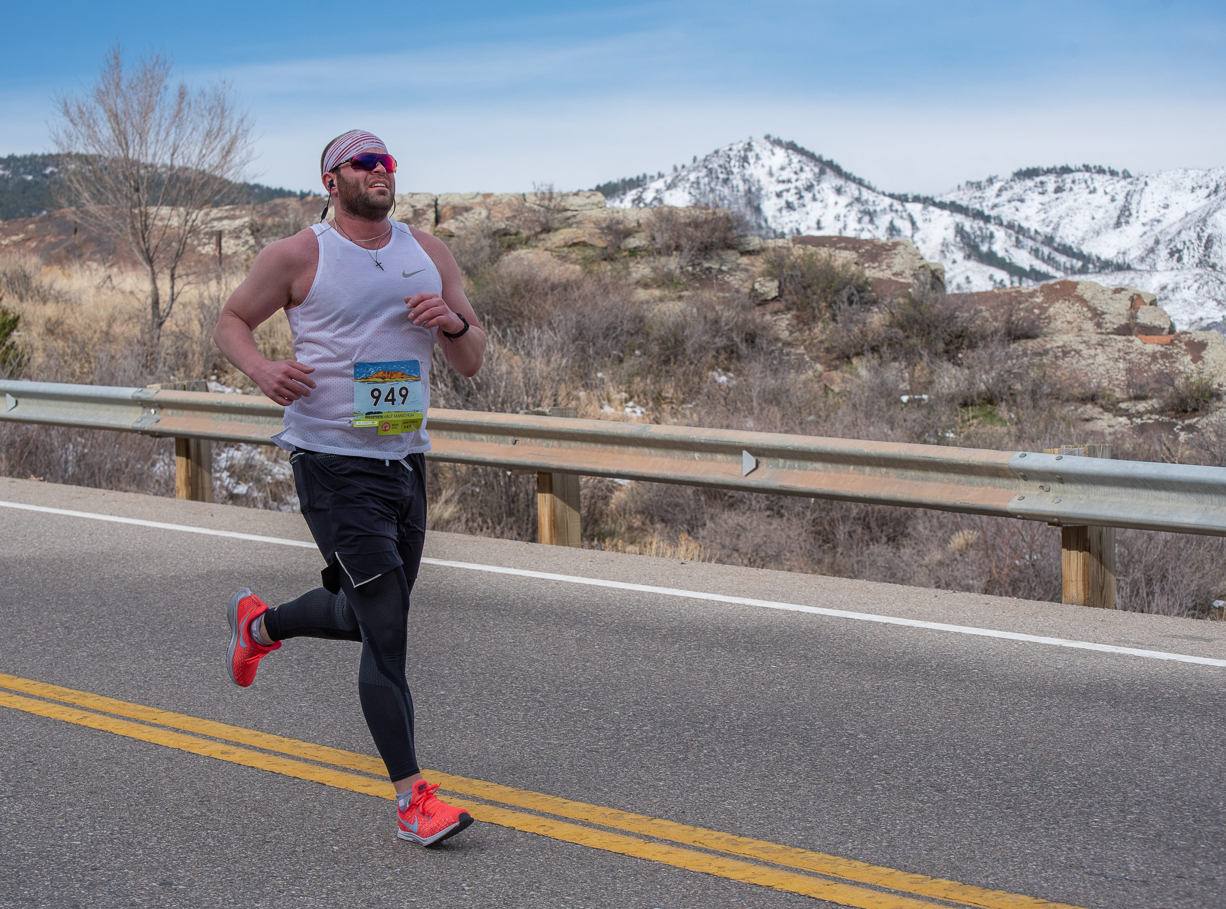 A participant descends a hill during the Horsetooth Half Marathon on Sunday, April 14, 2019, in Fort Collins, Colo.