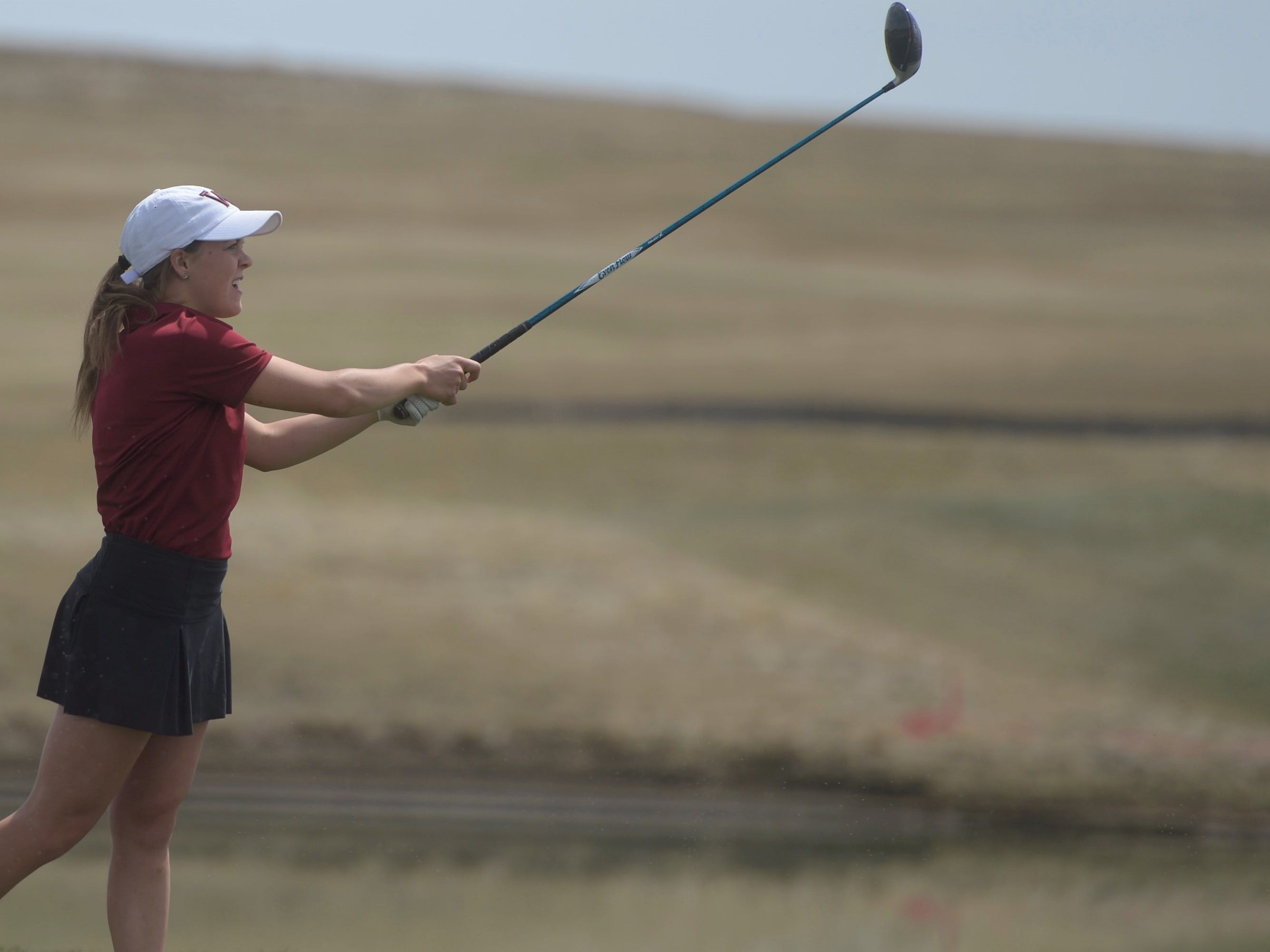 Windsor golfer Jessica Zapf watches a drive at the Tri-Valley League match at TPC Colorado in Berthoud on Monday, April 15. Windsor won the event. It's the first Tournament Players Club course in the state.