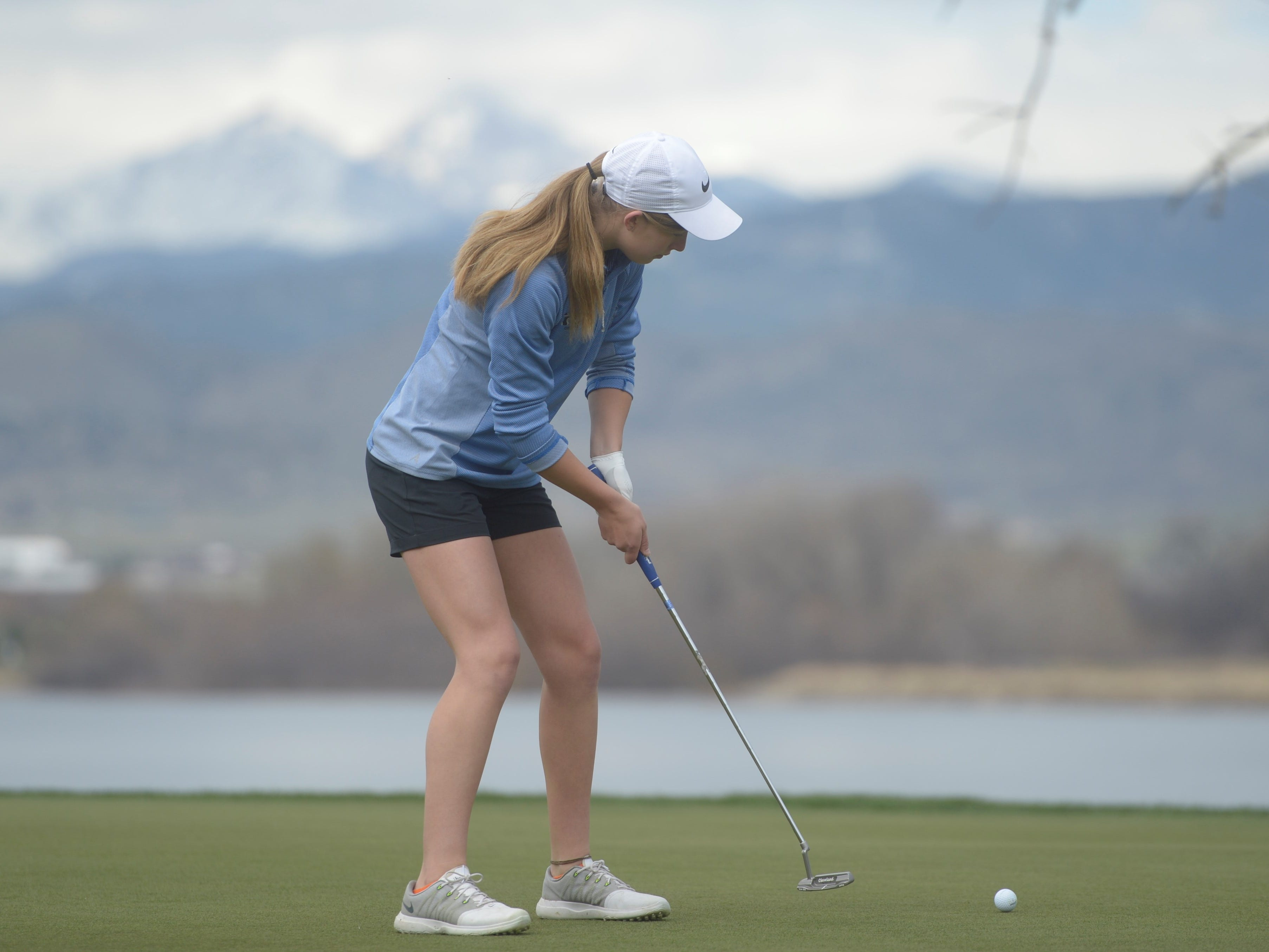 Resurrection Christian golfer Elisabeth Perl putts at the Tri-Valley League match at TPC Colorado in Berthoud on Monday, April 15. Windsor won the event. It's the first Tournament Players Club course in the state.