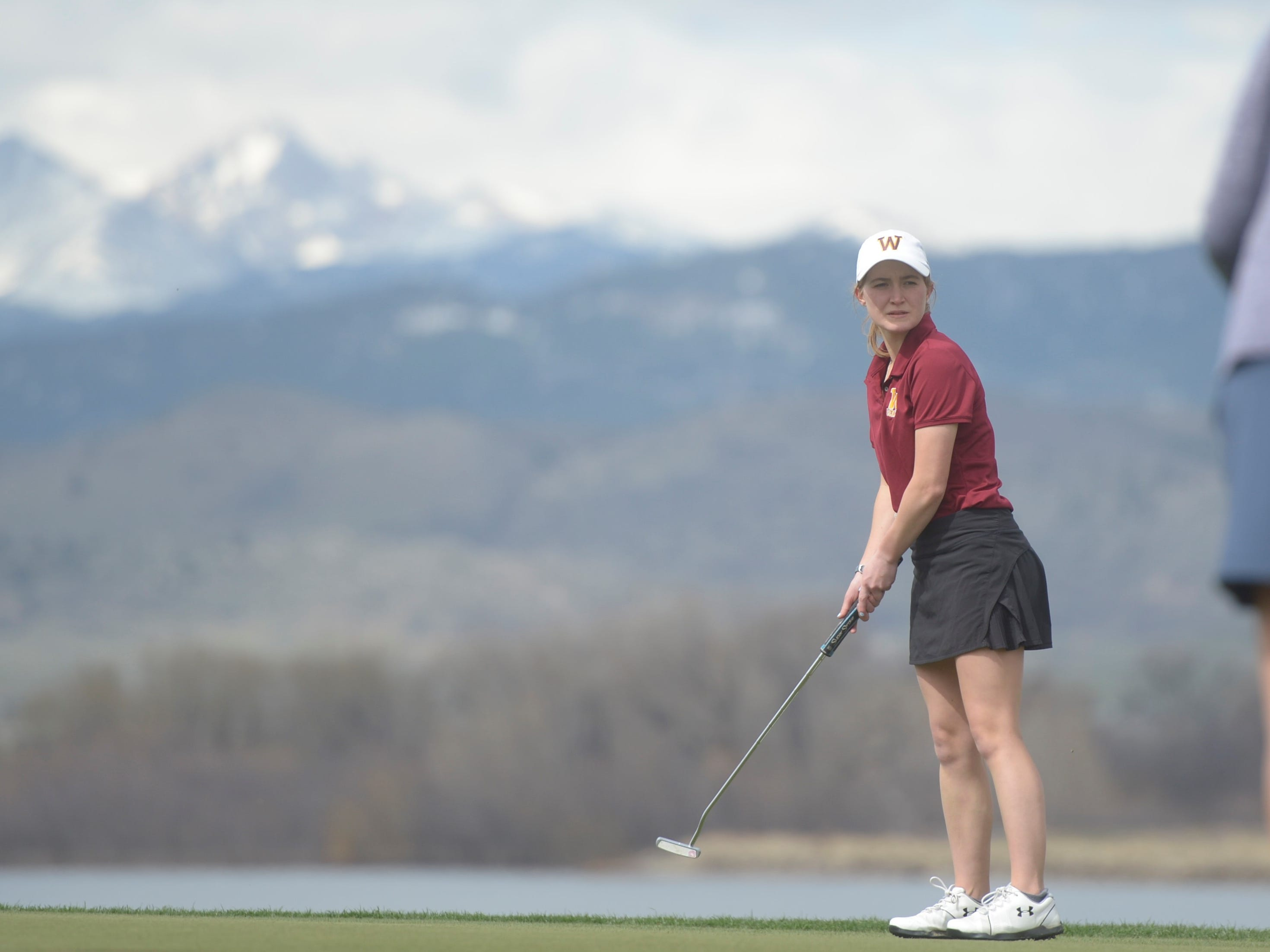Windsor golfer Kinsey Smith watches her putt on hole No. 8 at the Tri-Valley League match at TPC Colorado in Berthoud on Monday, April 15. Windsor won the event. It's the first Tournament Players Club course in the state.