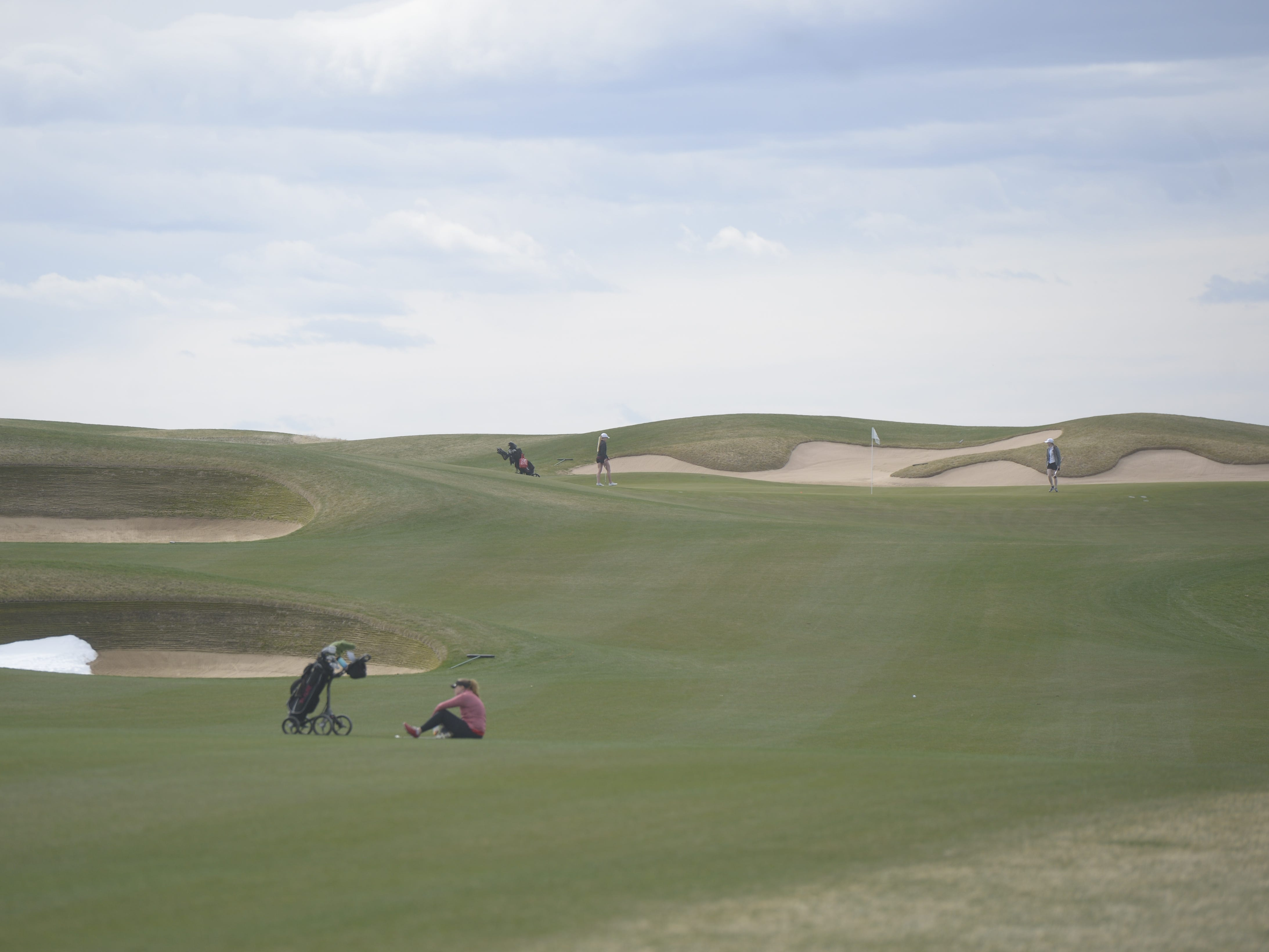 A golfer waits in the fairway for the green to clear at the Tri-Valley League match at TPC Colorado in Berthoud on Monday, April 15. Windsor won the event. It's the first Tournament Players Club course in the state.