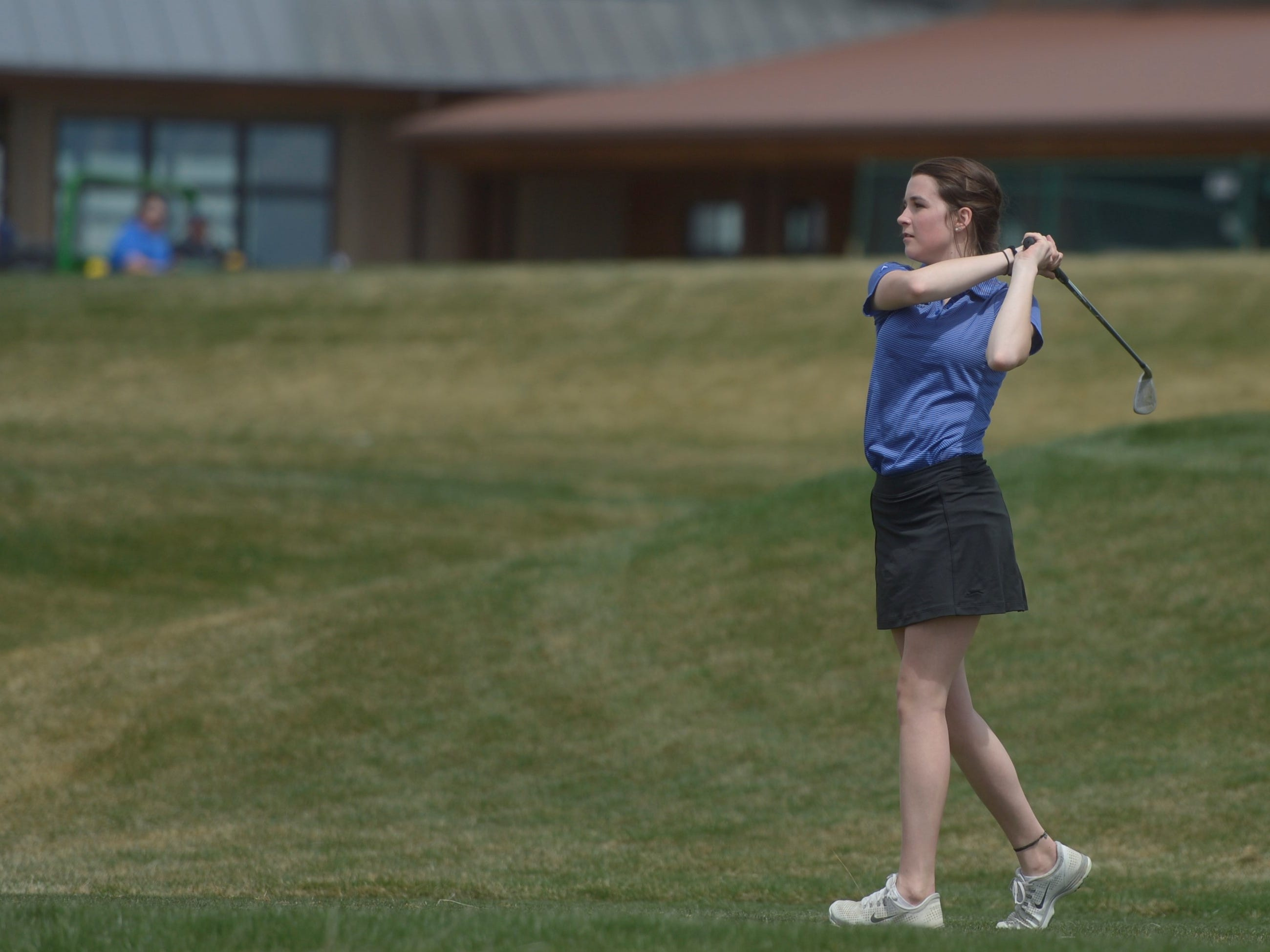 Resurrection Christian golfer Abby McFann watches her drive on hole No. 16 at the Tri-Valley League match at TPC Colorado in Berthoud on Monday, April 15. Windsor won the event. It's the first Tournament Players Club course in the state.