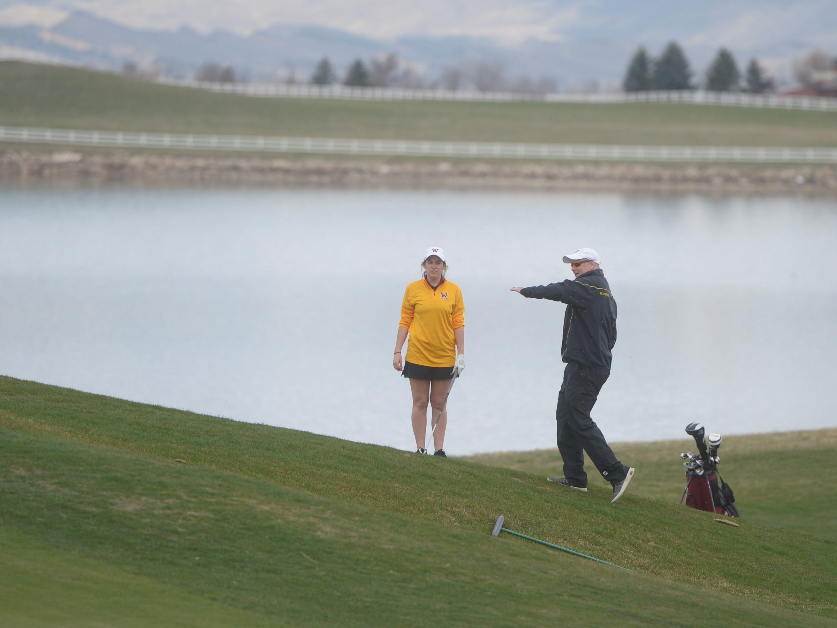 Windsor golfer Anna Nacy, left, talks with coach Kenny Anderson at the Tri-Valley League match at TPC Colorado in Berthoud on Monday, April 15. Windsor won the event. It's the first Tournament Players Club course in the state.