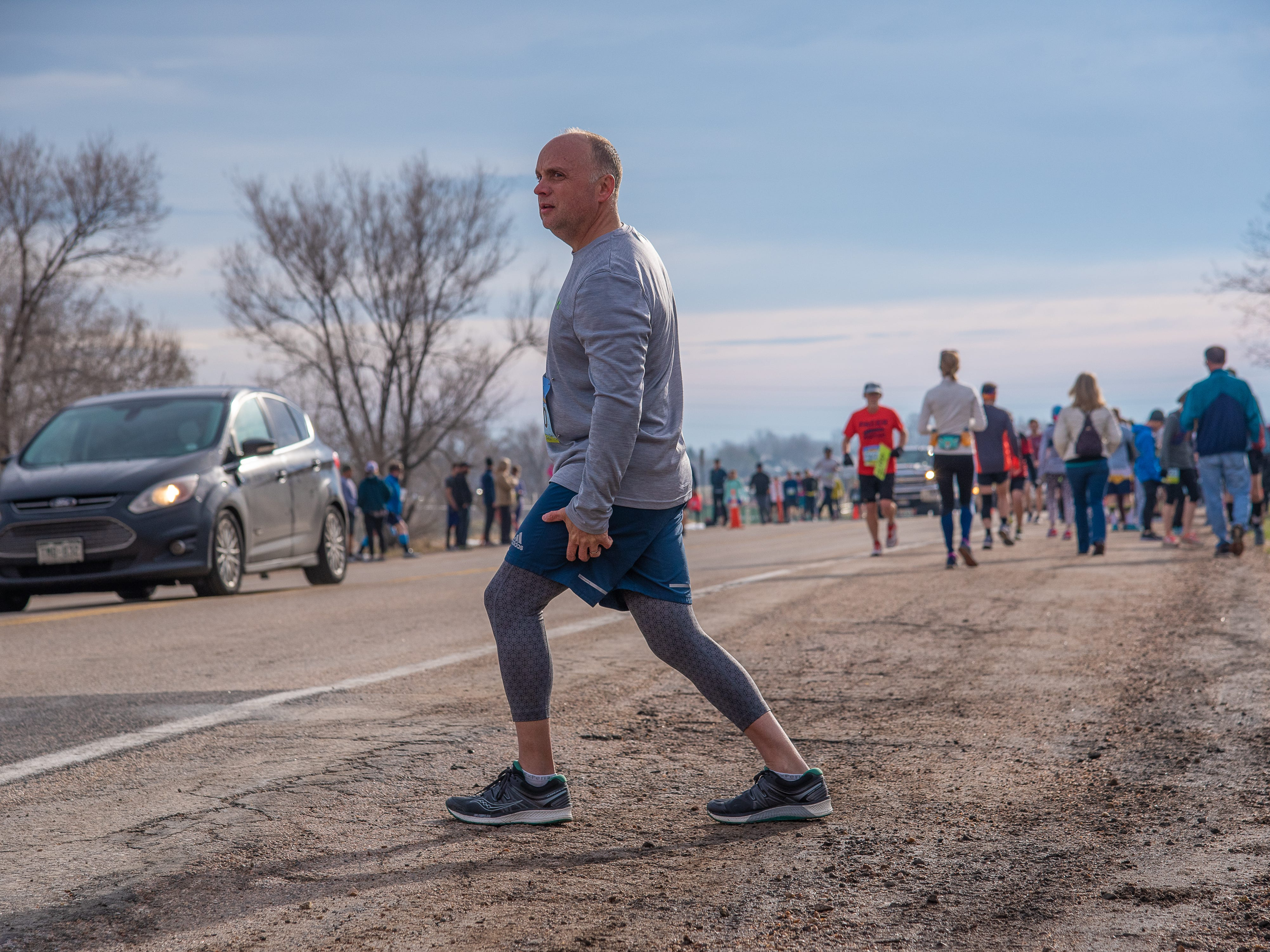 A participant limbers up before the start of the Horsetooth Half Marathon on Sunday, April 14, 2019, in Fort Collins, Colo.