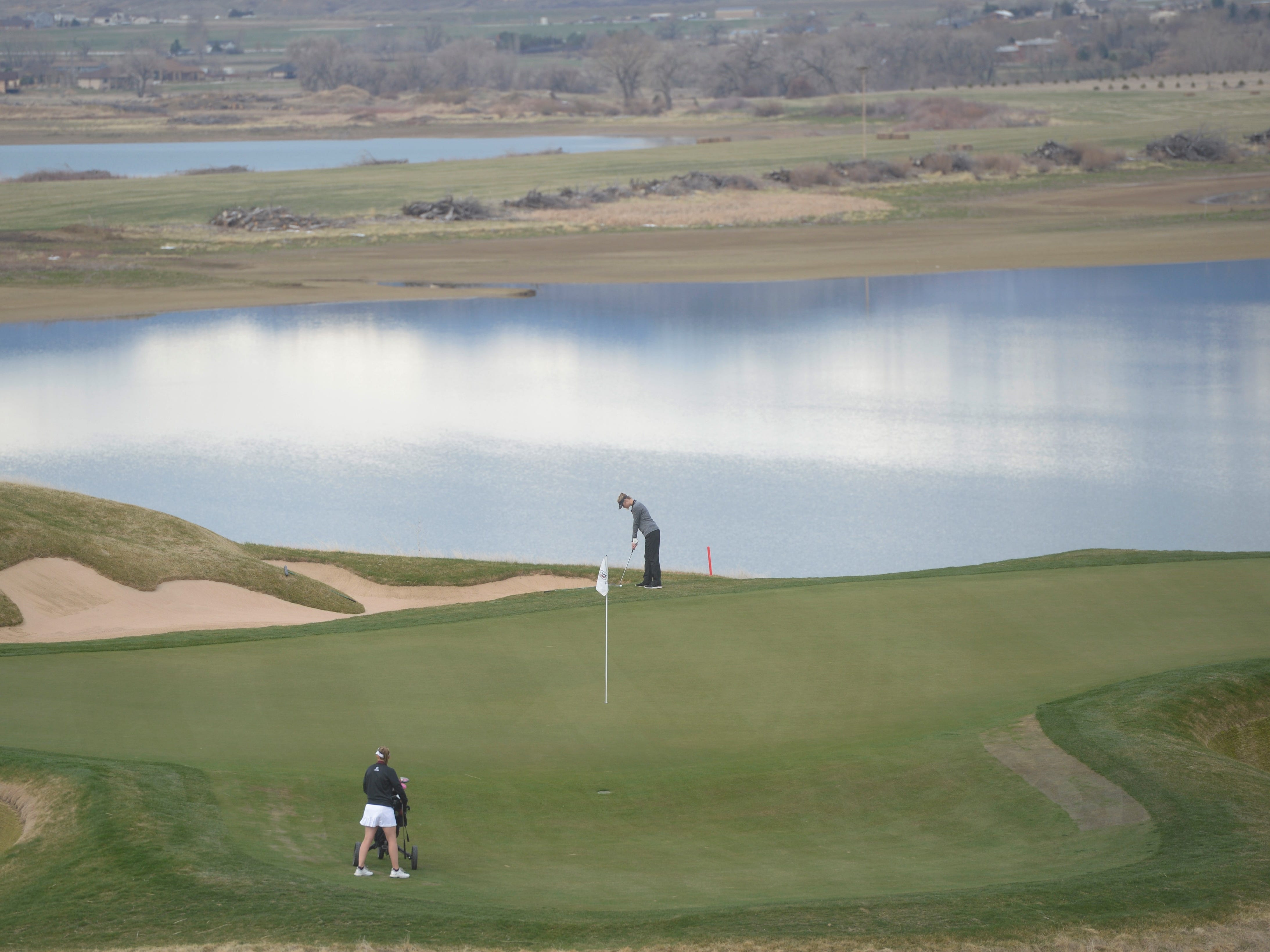 Golfers hit on hole No. 16 at the Tri-Valley League match at TPC Colorado in Berthoud on Monday, April 15. Windsor won the event. It's the first Tournament Players Club course in the state.