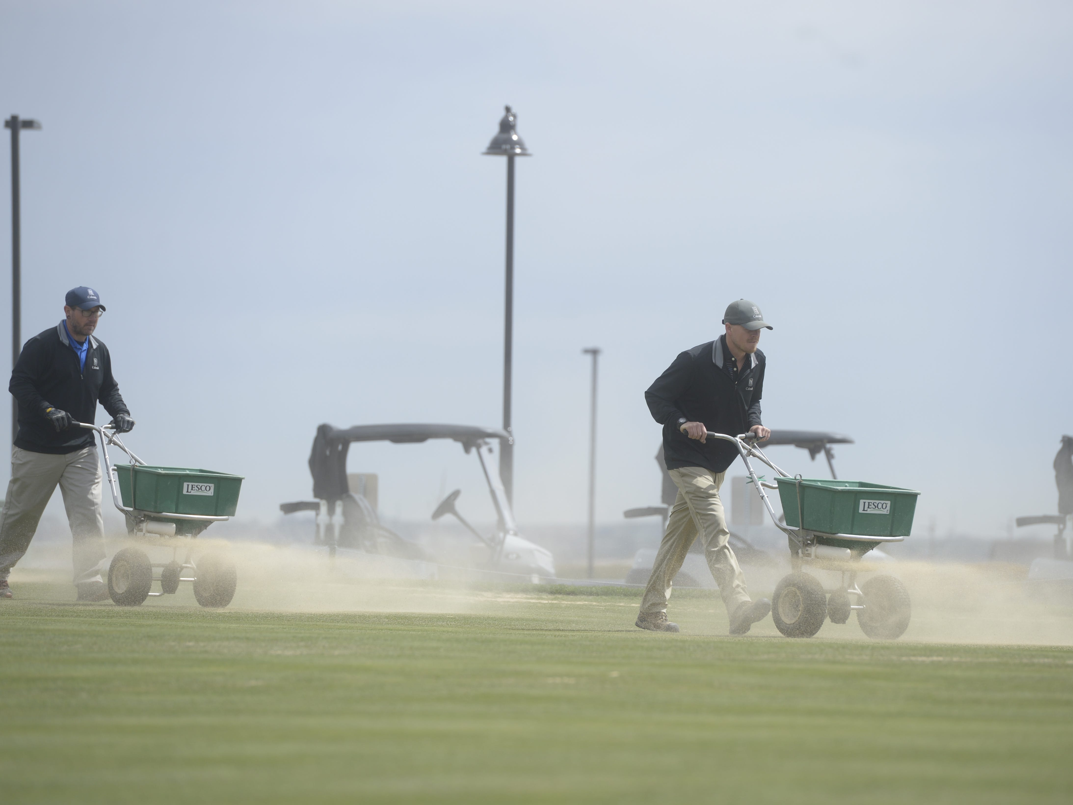 Workers at TPC Colorado work on a practice green on Monday, May 15, 2019.