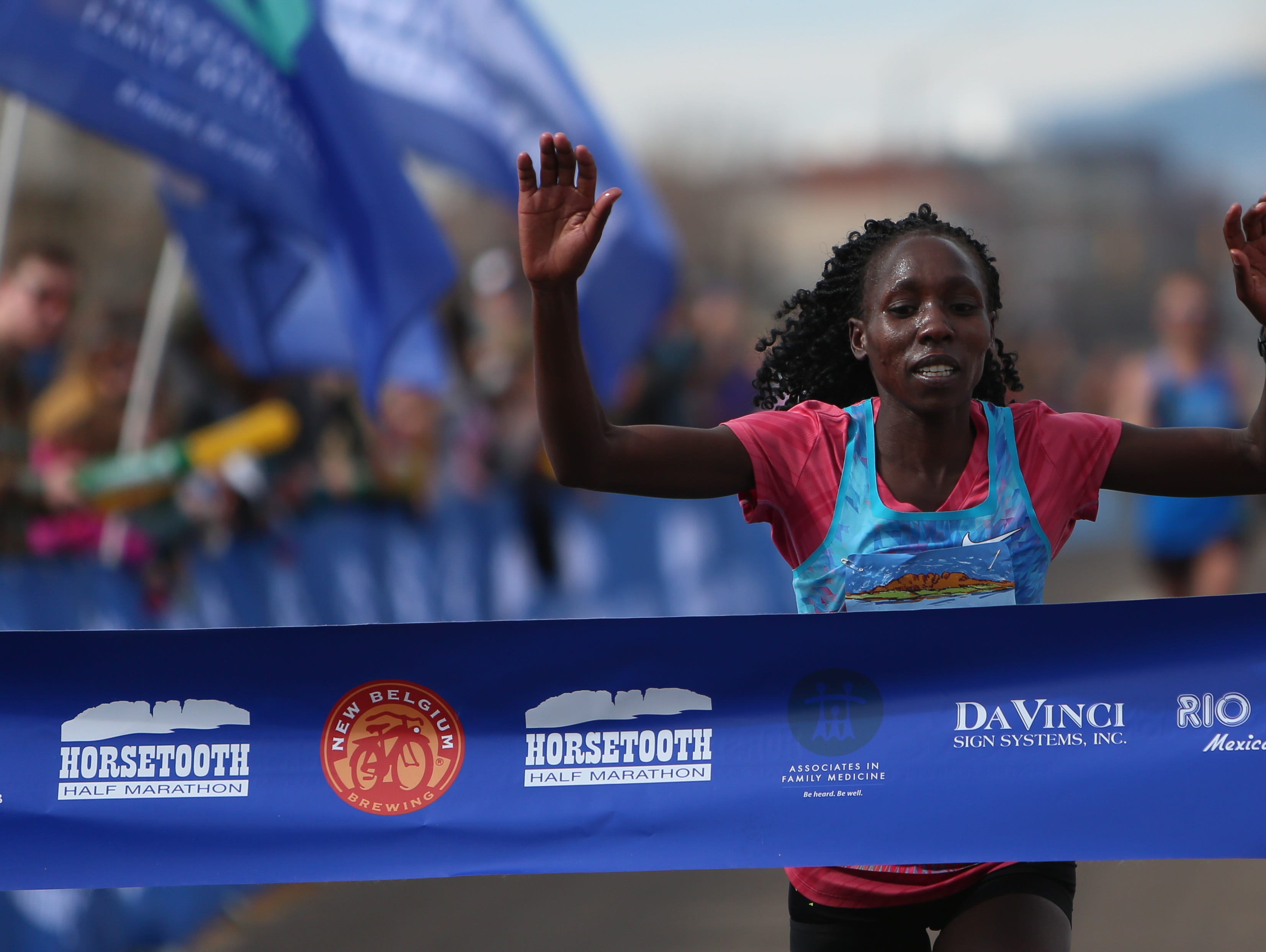 Ivy Kibet completes the Horsetooth Half Marathon as the first female participant on April 14.
