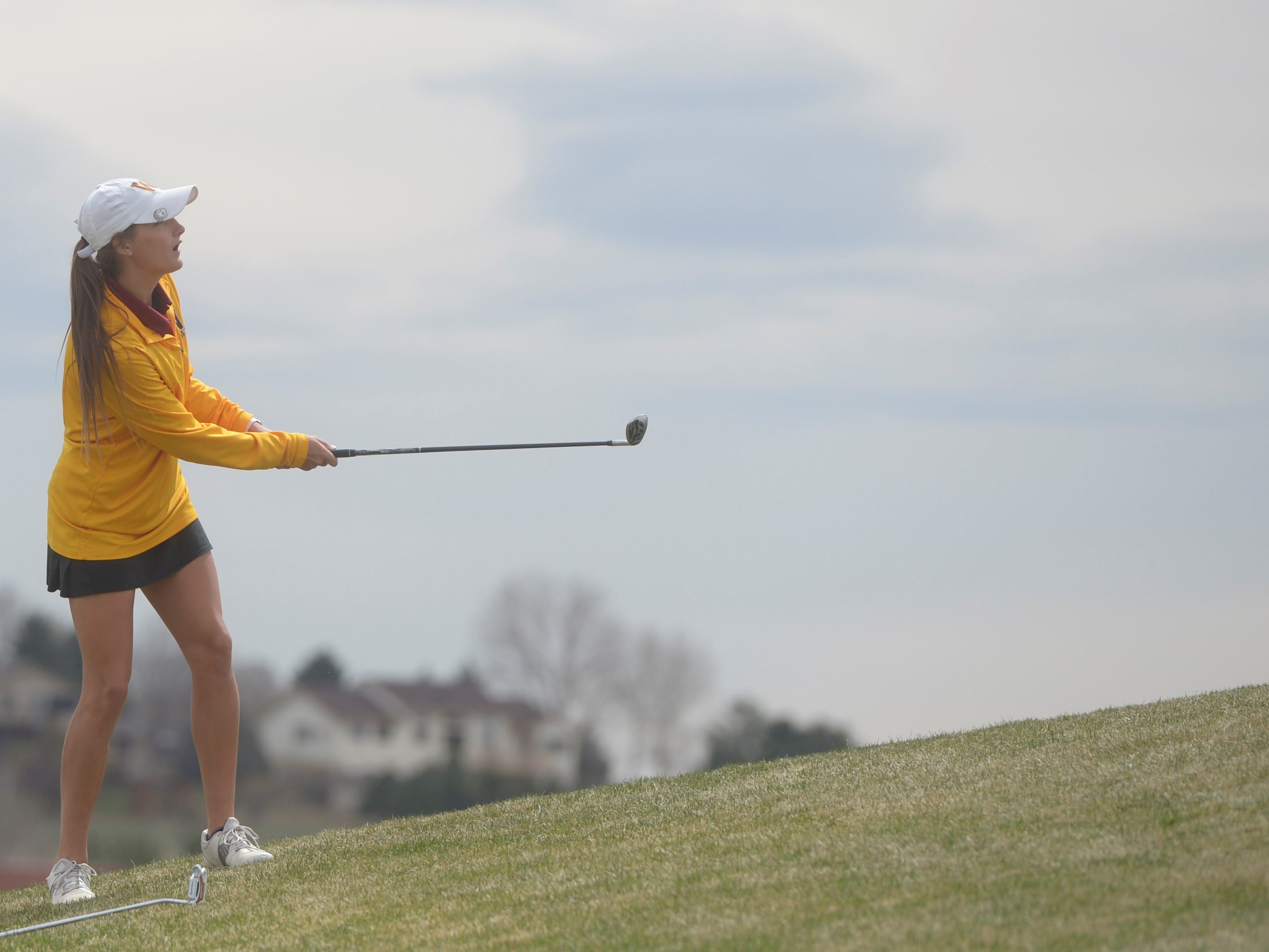 Windsor golfer Sarah Johnson watches a chip shot at the Tri-Valley League match at TPC Colorado in Berthoud on Monday, April 15. Windsor won the event. It's the first Tournament Players Club course in the state.
